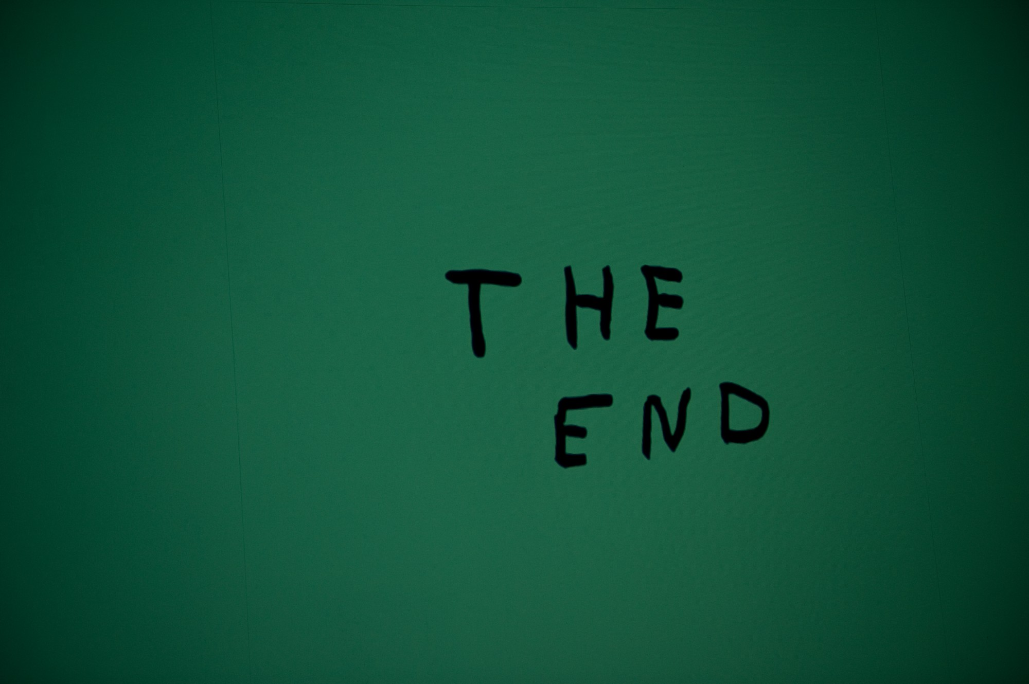 """A green background with the text saying """"the end"""""""