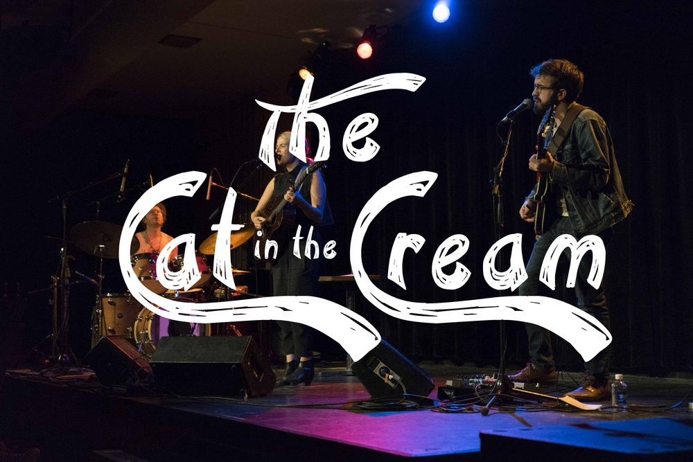 The Cat in the Cream logo over an artist performing in the venue. Via https://www.annikaizora.com/work/the-cat-in-the-cream
