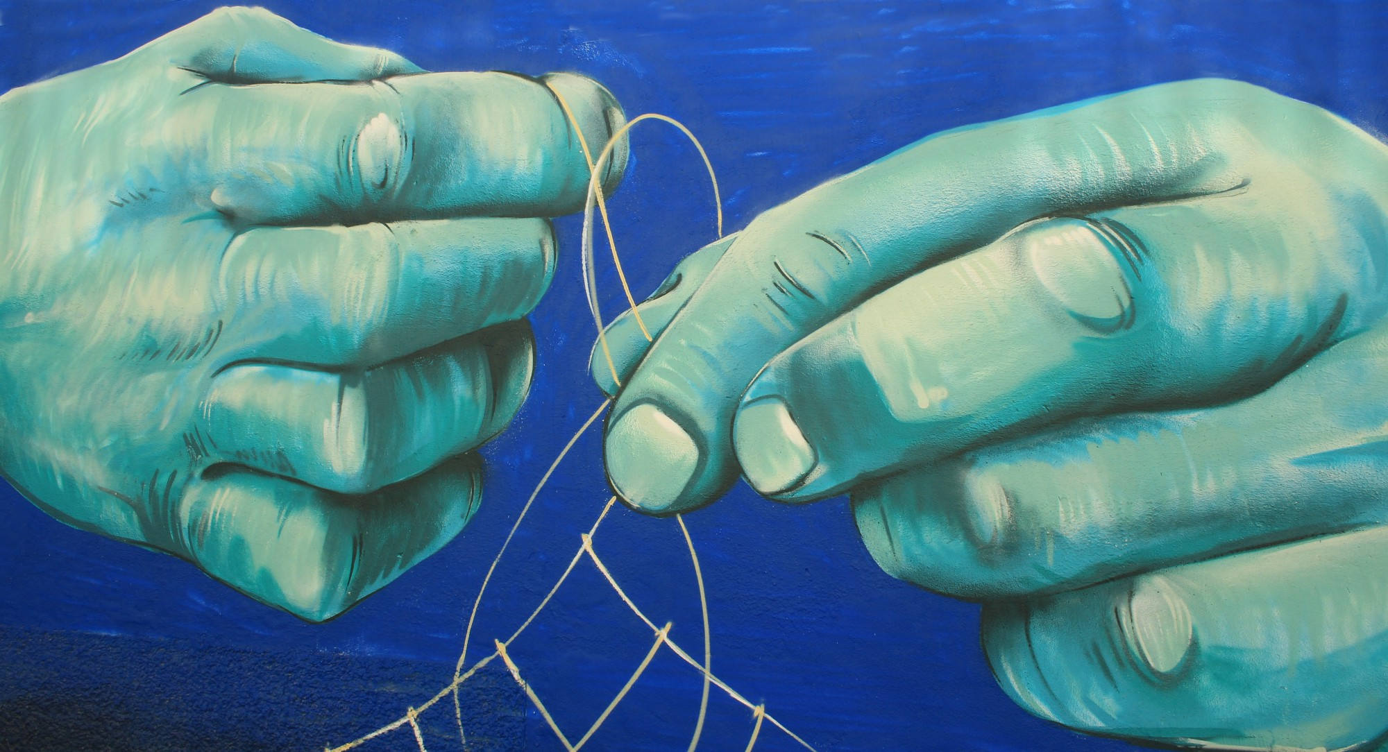 a drawing of hands tying string.