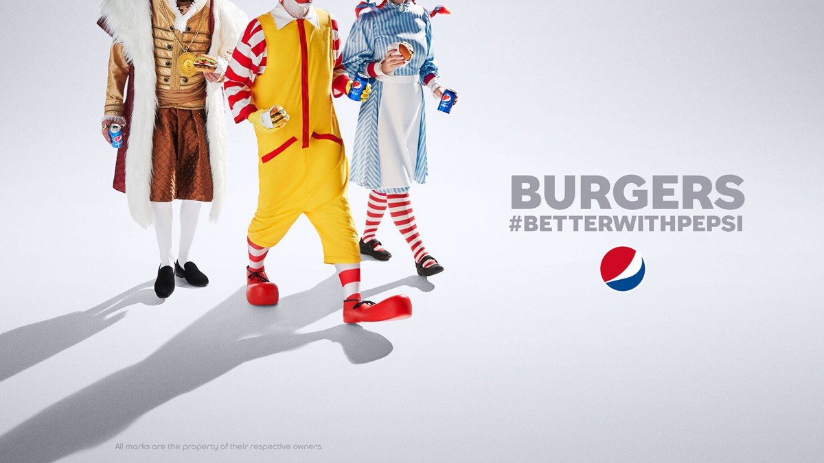 Burgers #BetterWithPepsi ad showing the outfits of the Burger King, McDonald's and Wendy's mascots.