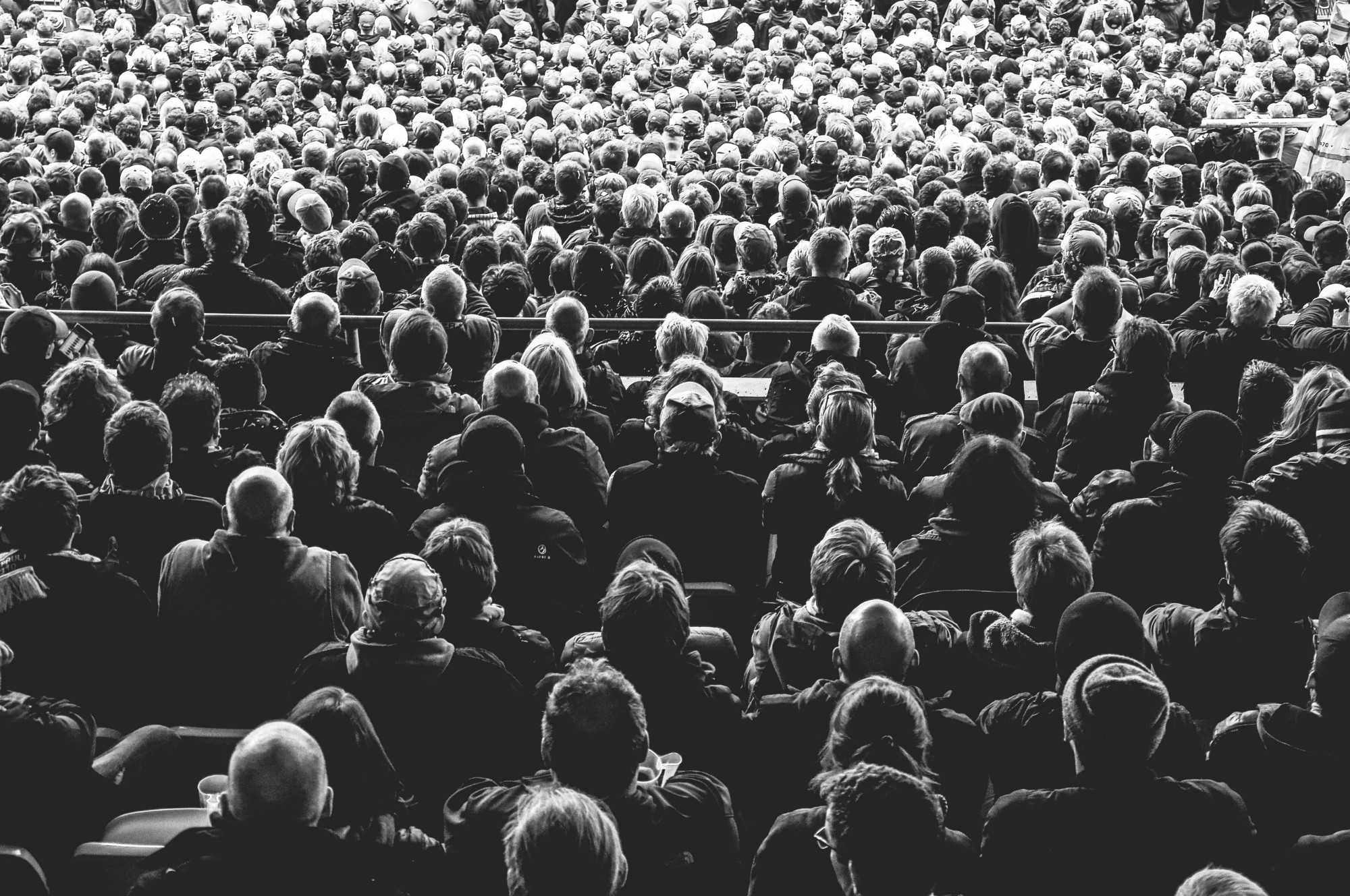 Black and white photo of a large audience