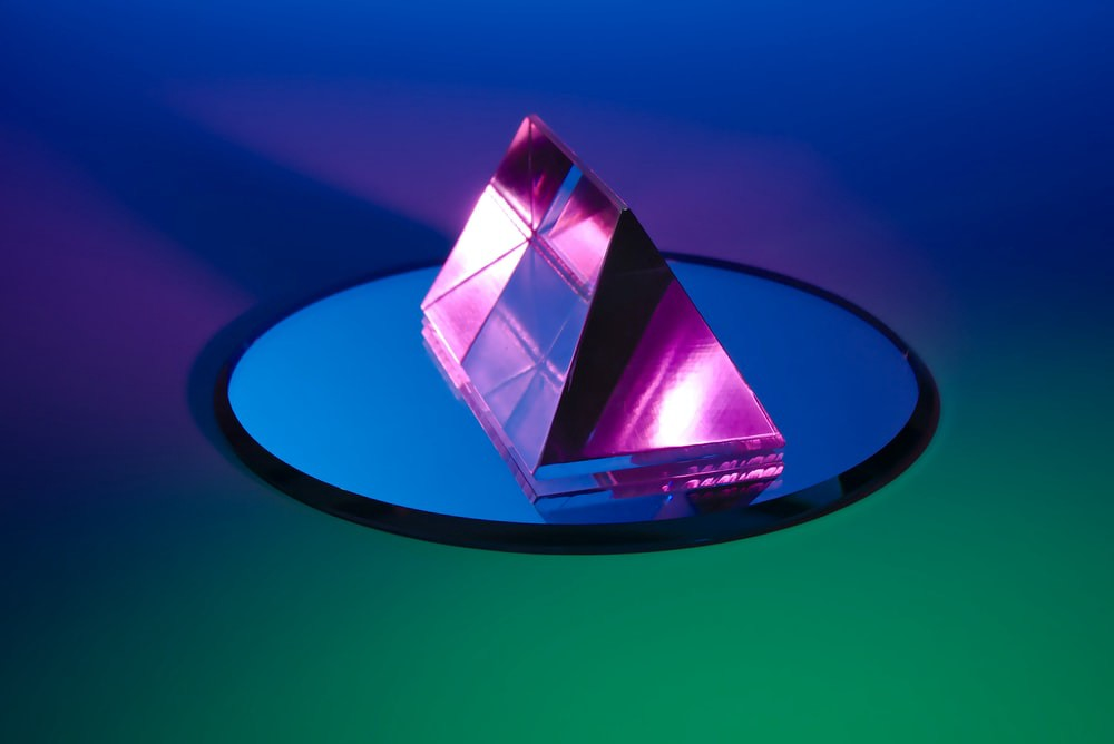 Photograph of a prism and a mirror.