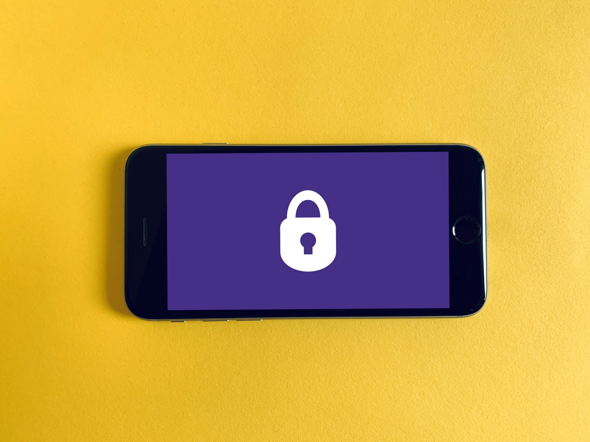 A phone with lock photo on the screen