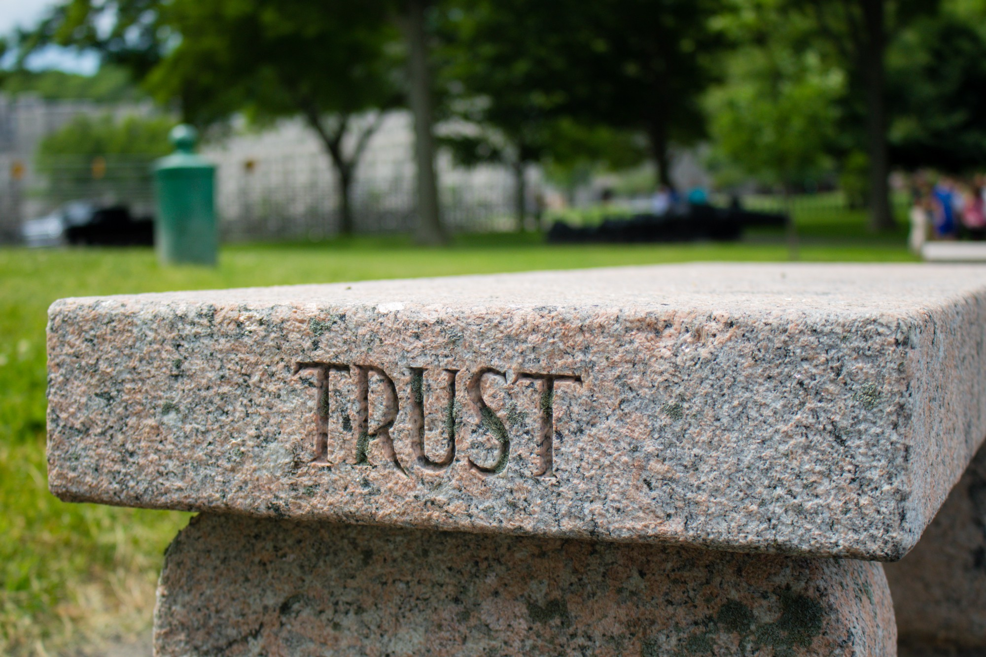 """A stone slab with the word """"Trust"""" engraved on it"""