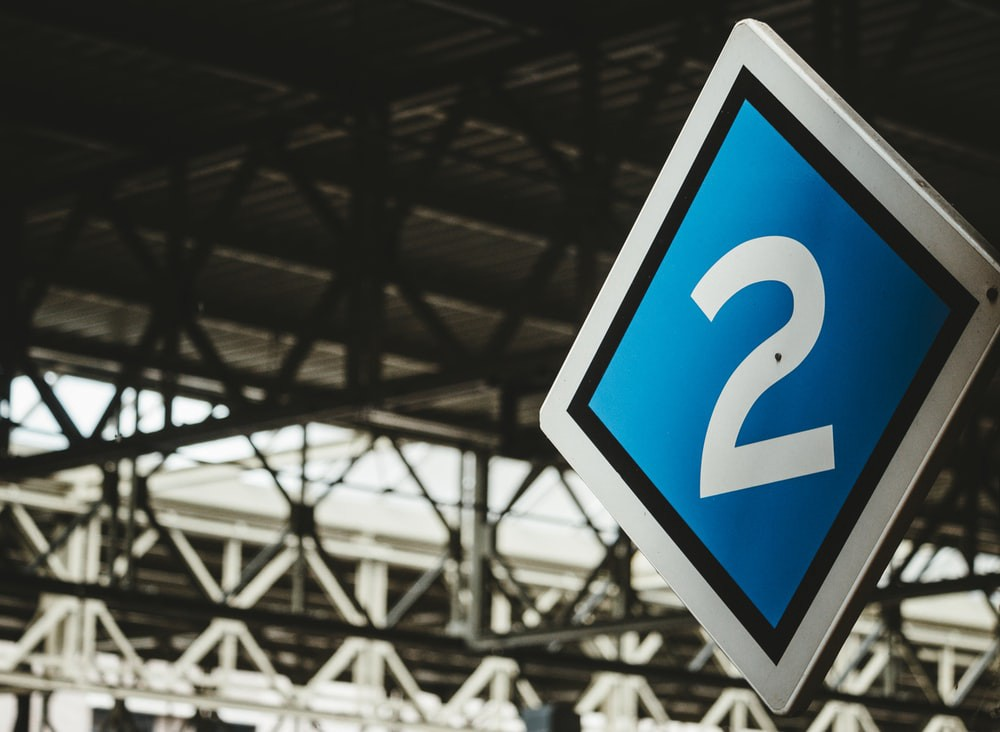 Blue and gray number 2 signage