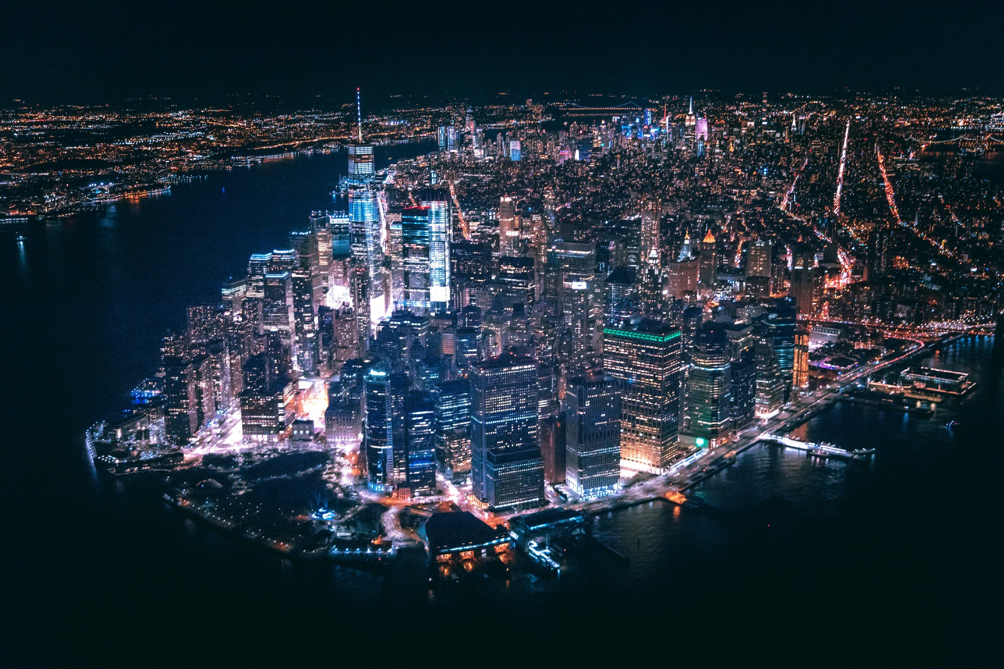 An aerial shot of downtown Manhattan at night.