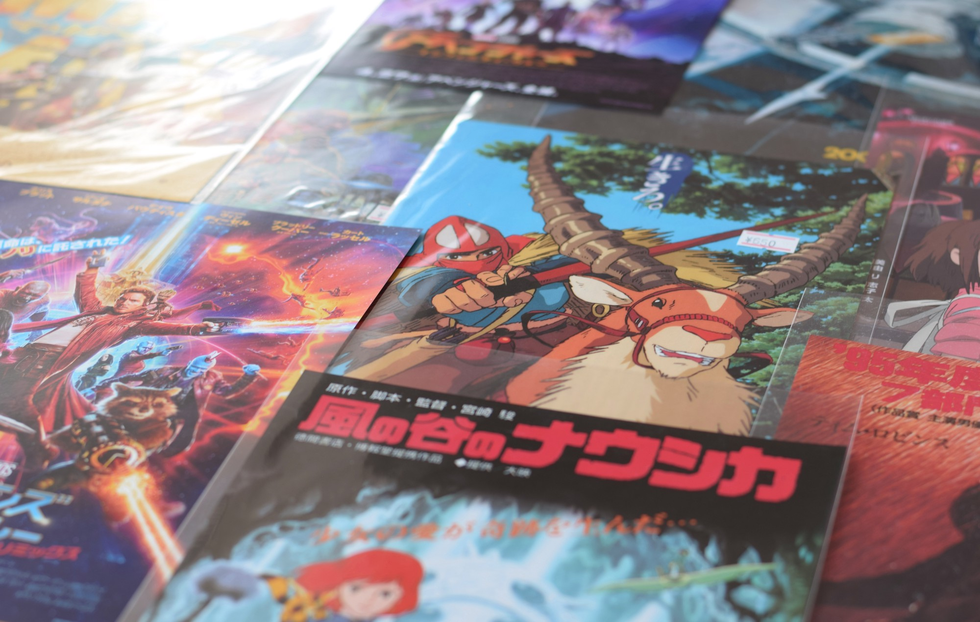Comic book covers—some in Japanese.