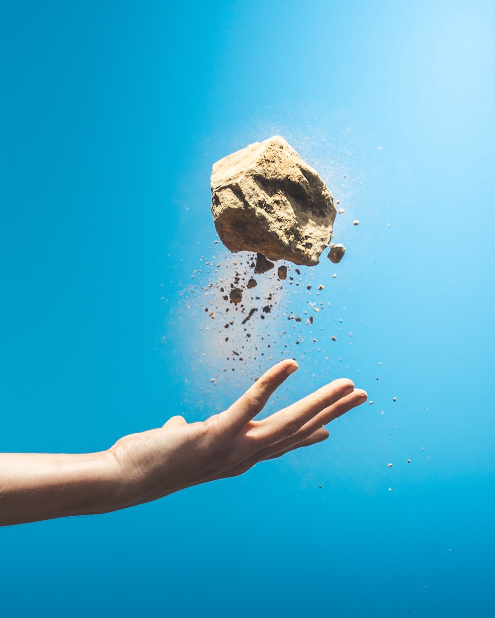 Person throwing a rock photo