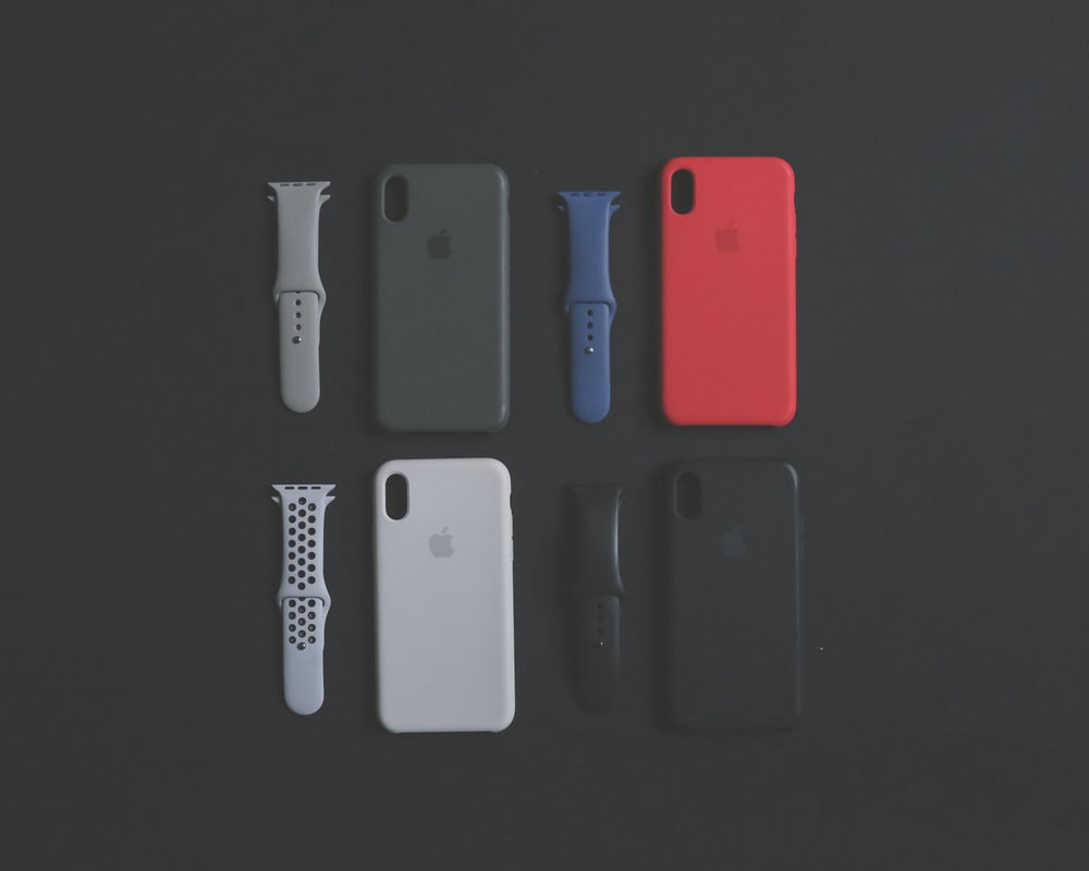 4 assorted color iPhone XS cases and Apple Watch bands