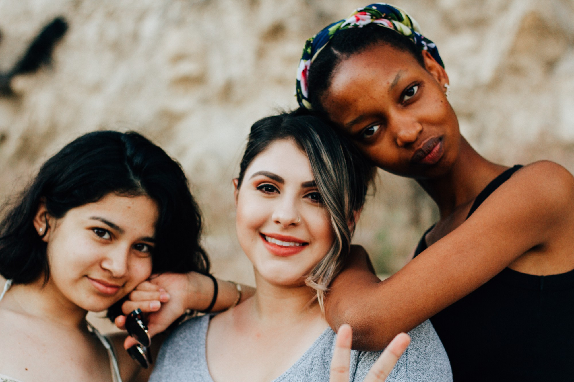 Three young women of different ethnicity.