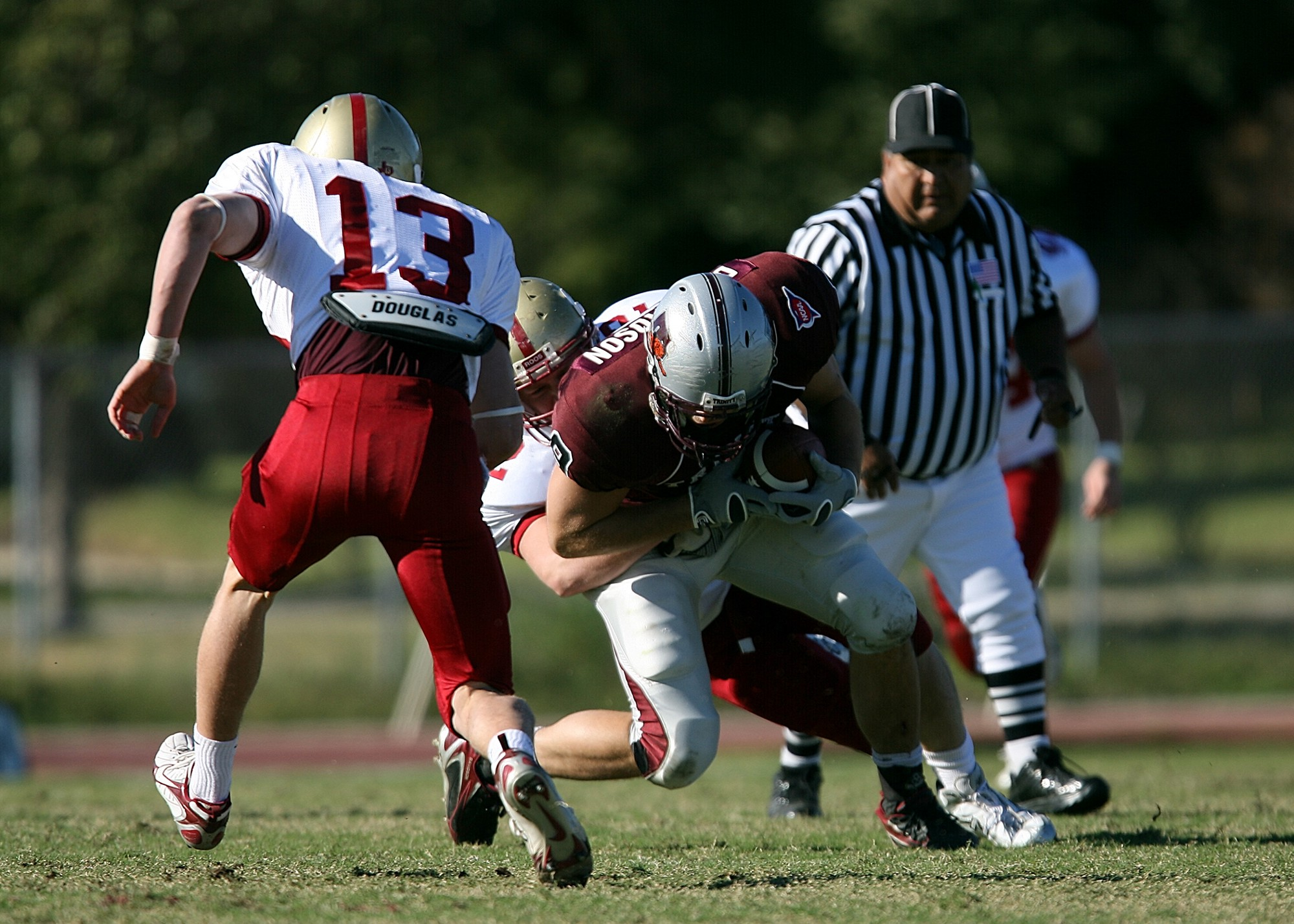 Football player being tackled.