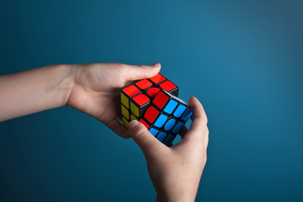 Image of person playing with a Rubik's Cube