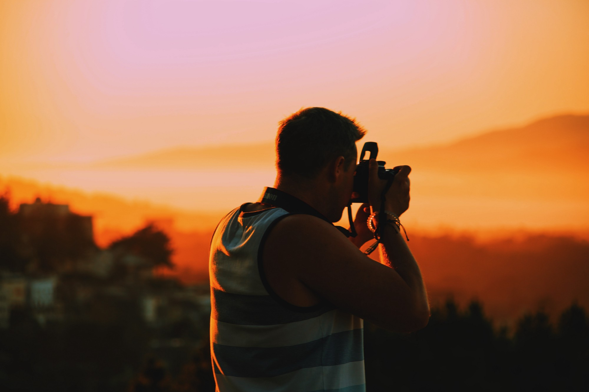 A photographer making an image of a sunset.