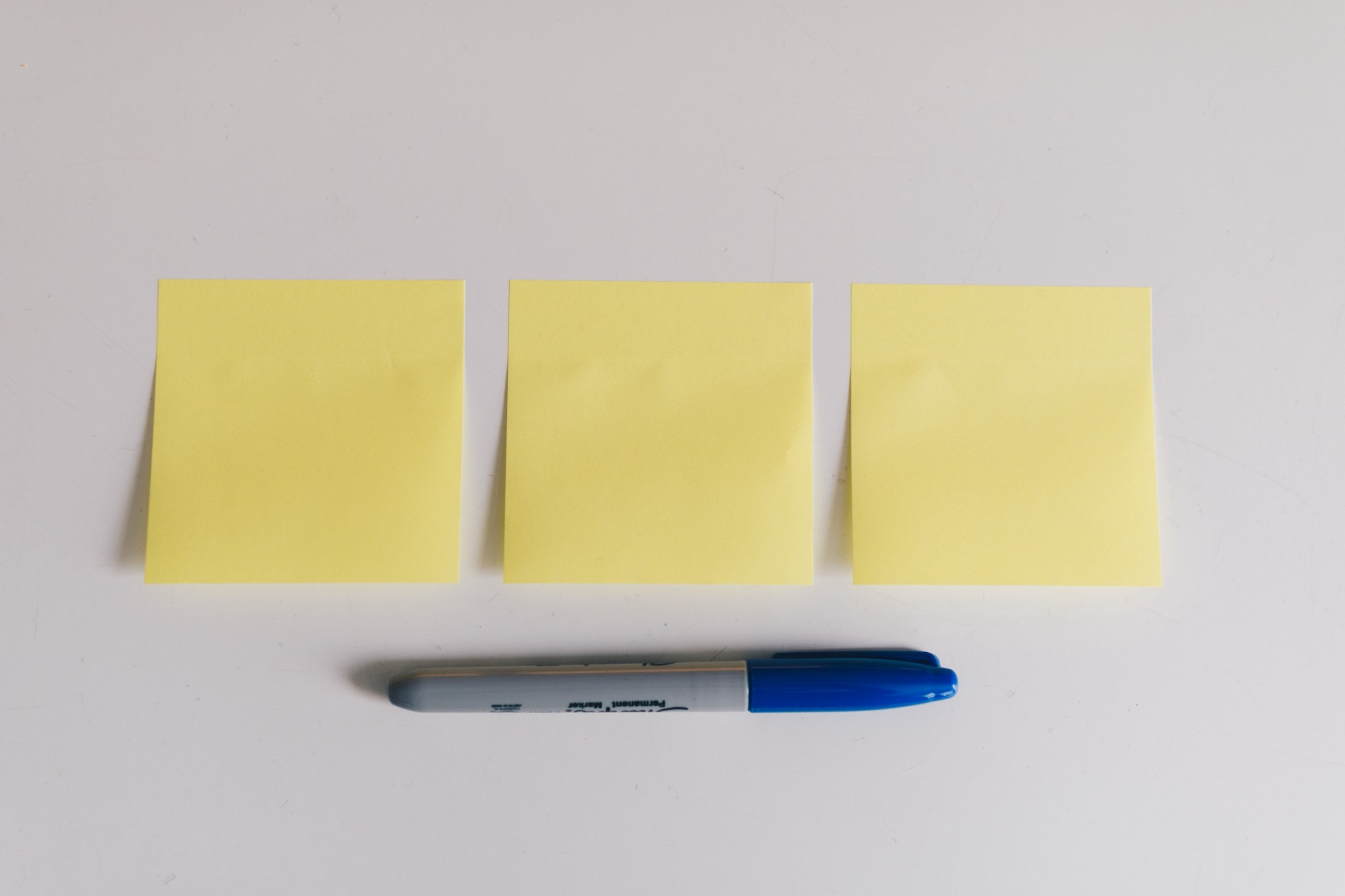 Blank sticky notes and a pen.