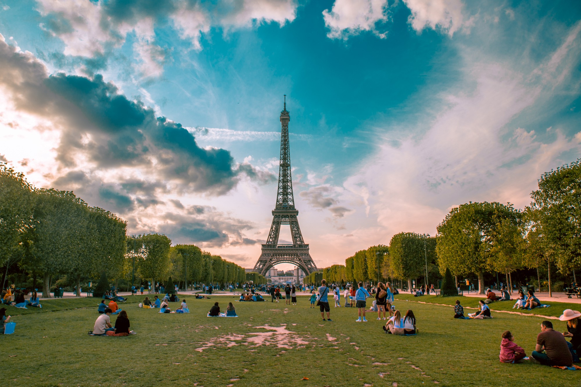 A lively park in front of the Eiffel tower