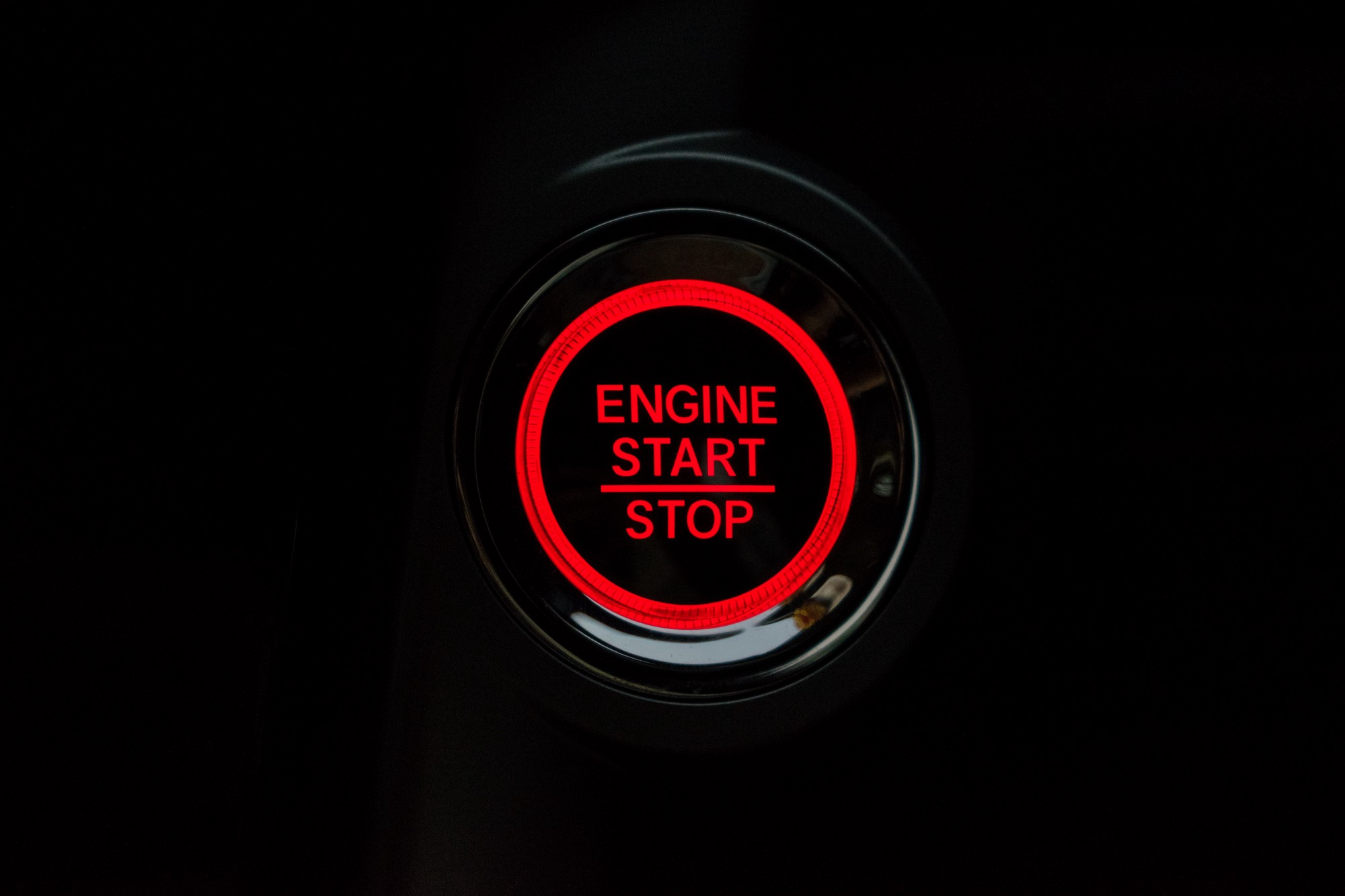 An engine button that says start and stop in red
