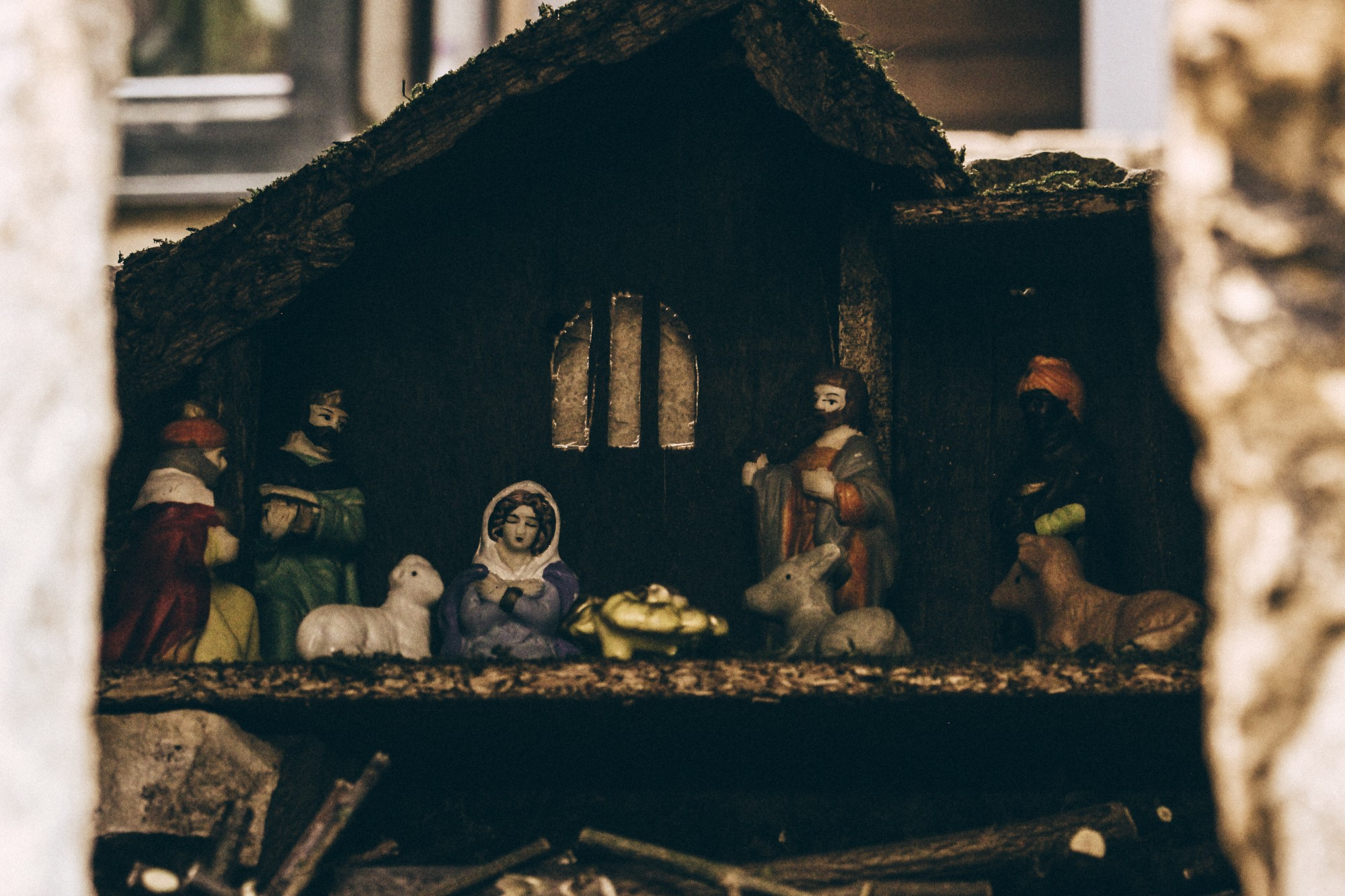 A Nativity set with baby Jesus in the center of the scene, surrounded by Mary, Joseph, animals, and magi.