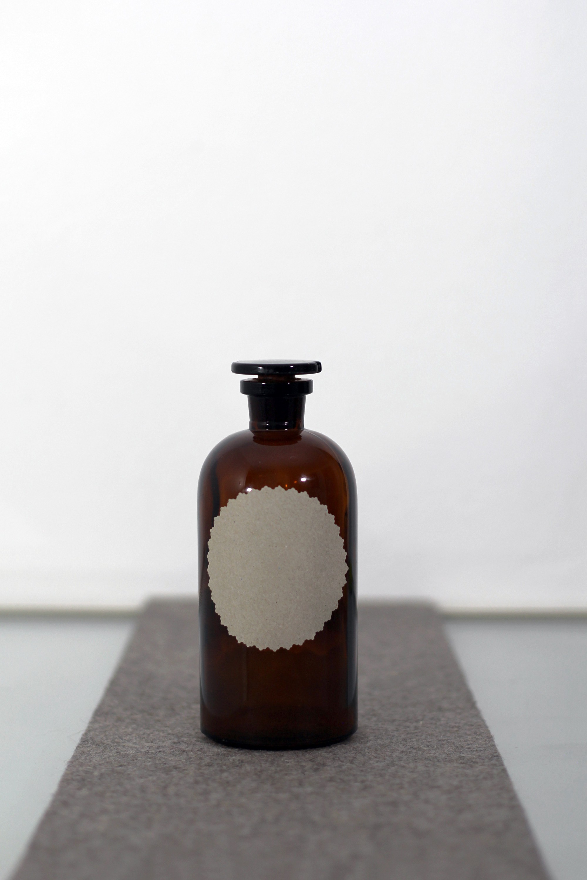 Antique brown bottle with a blank label