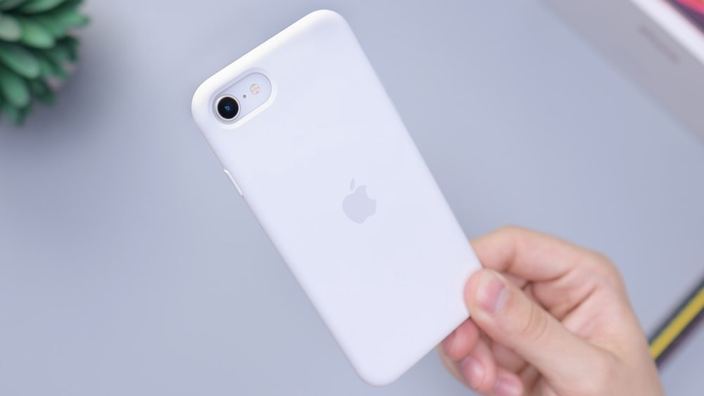 Photo of iPhone SE in white Apple branded case