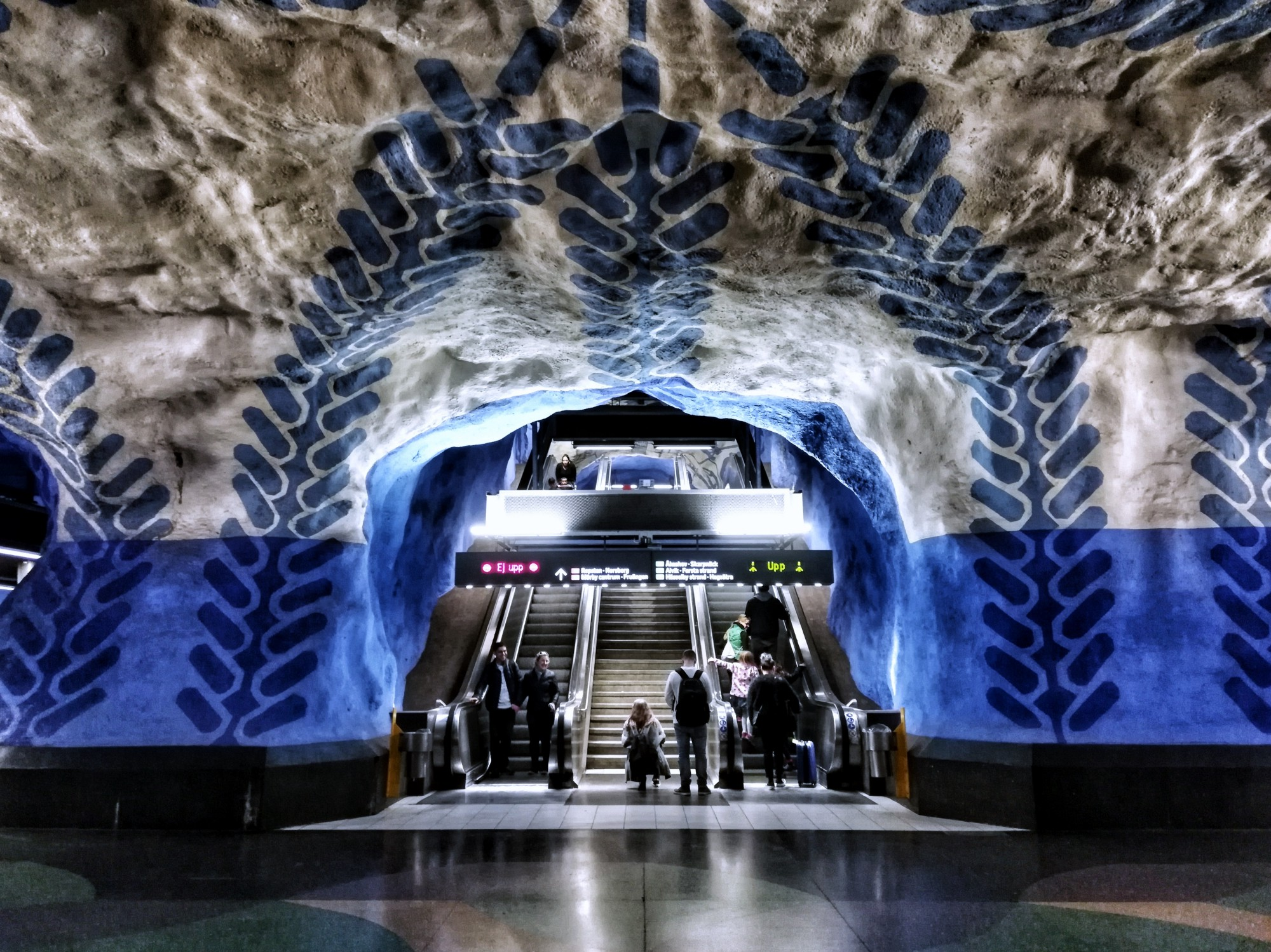 subway tunnel carved out of rock, painted with graphiti