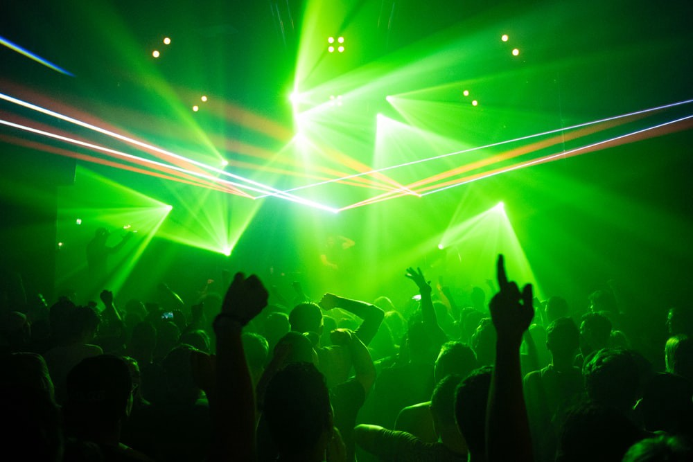 Green lights and crowds of techno party aka rave