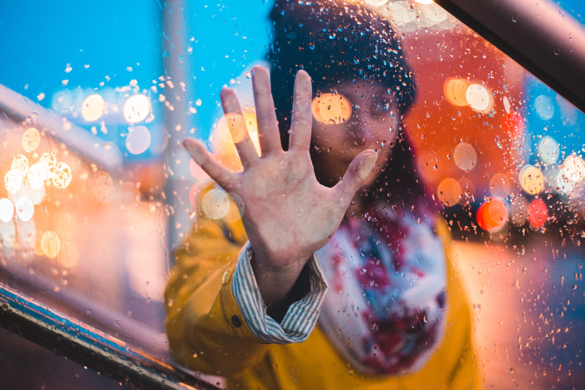 Woman looking through a rain-spattered window Run Away Wife I Lived in a Domestic Violence Shelter for Almost a Year Julia Freeman Domestic Violence Narcissistic Abuse Survivor Ninja Writer's Challenge