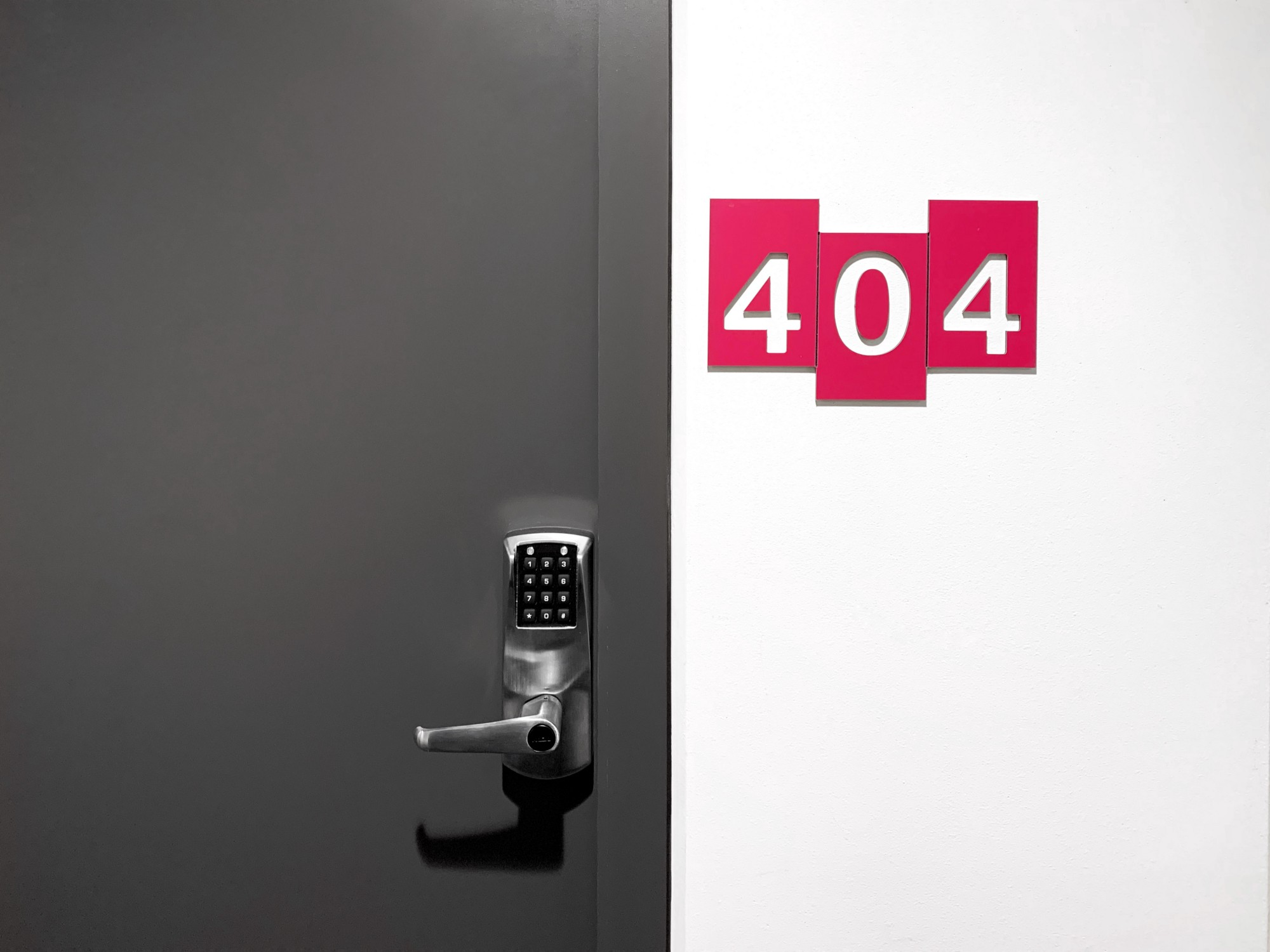 An exterior door with keyless entry. This door uses a number code system.