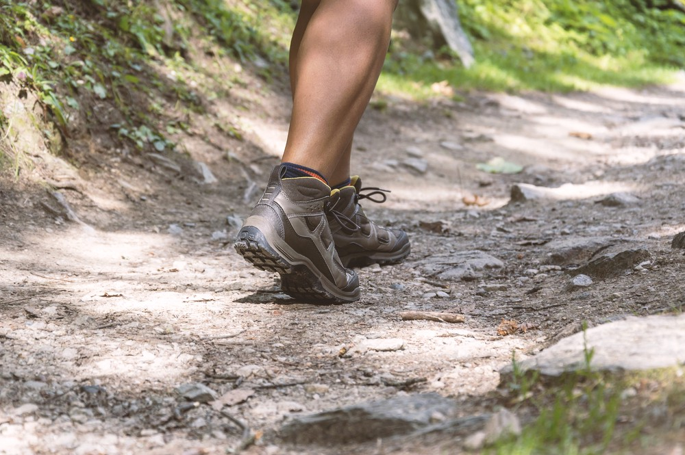 Close up of feet in hiking shoes on a trail