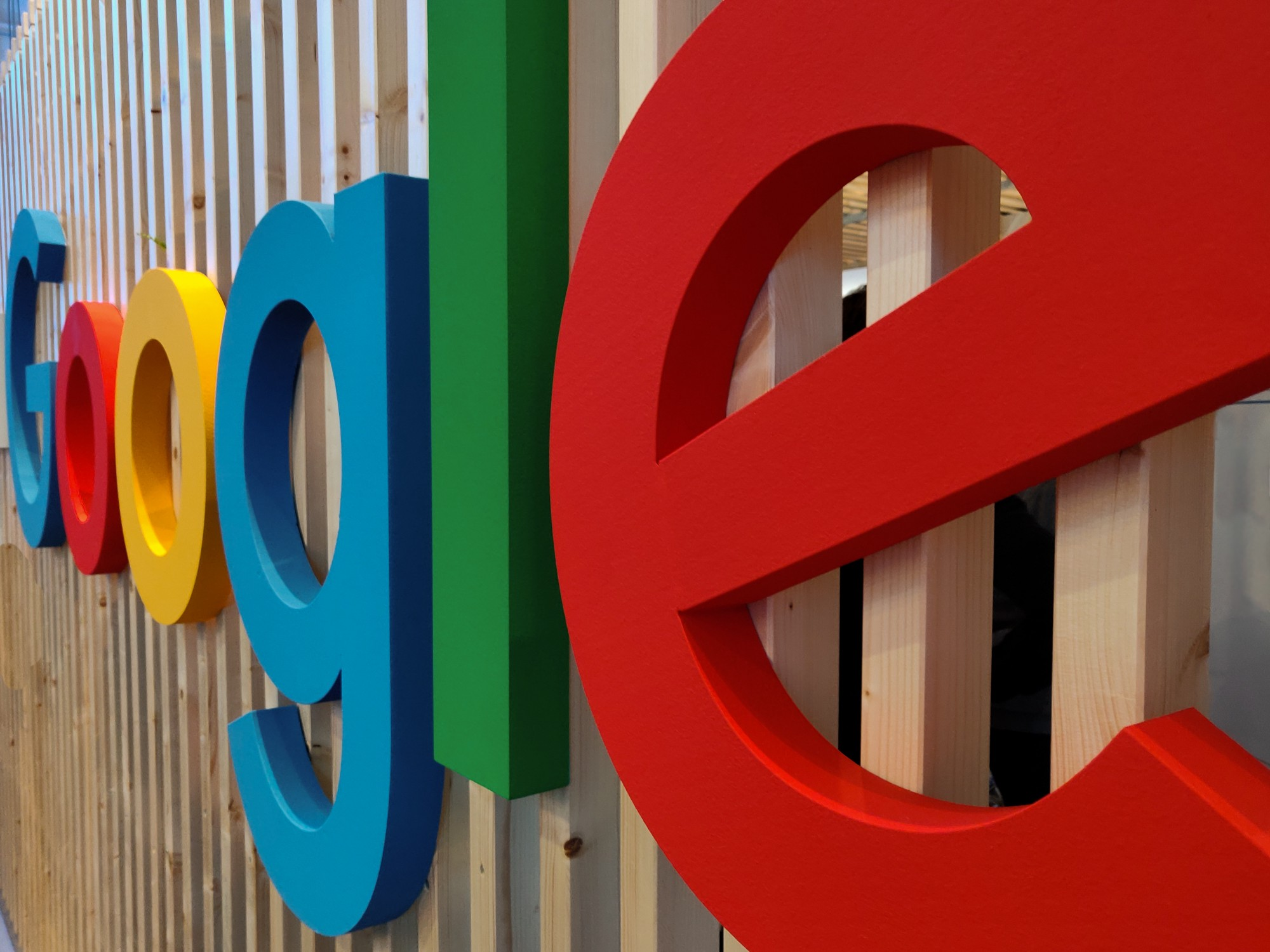 The Google sign on a wooden building.