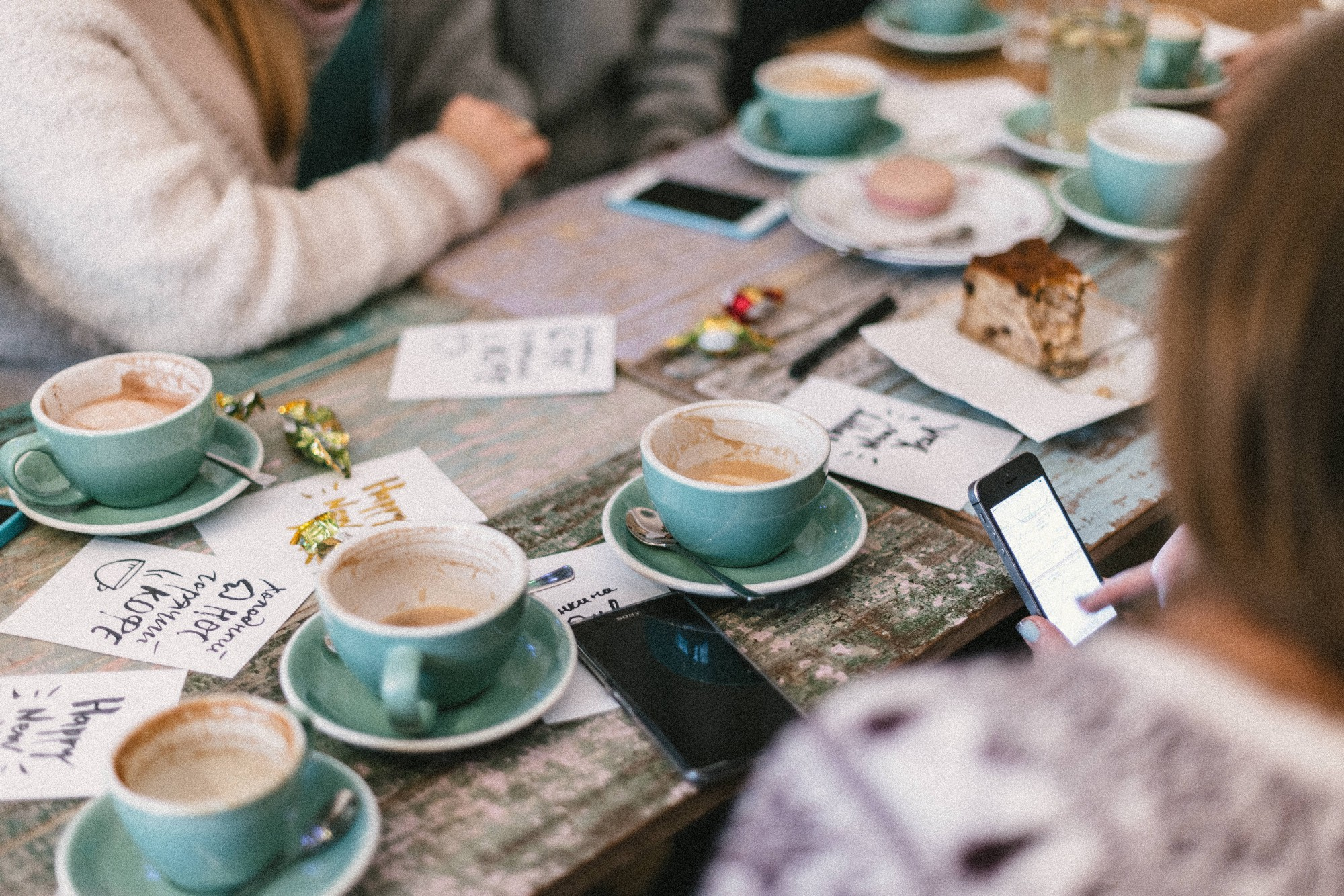 People drinking coffee around the table