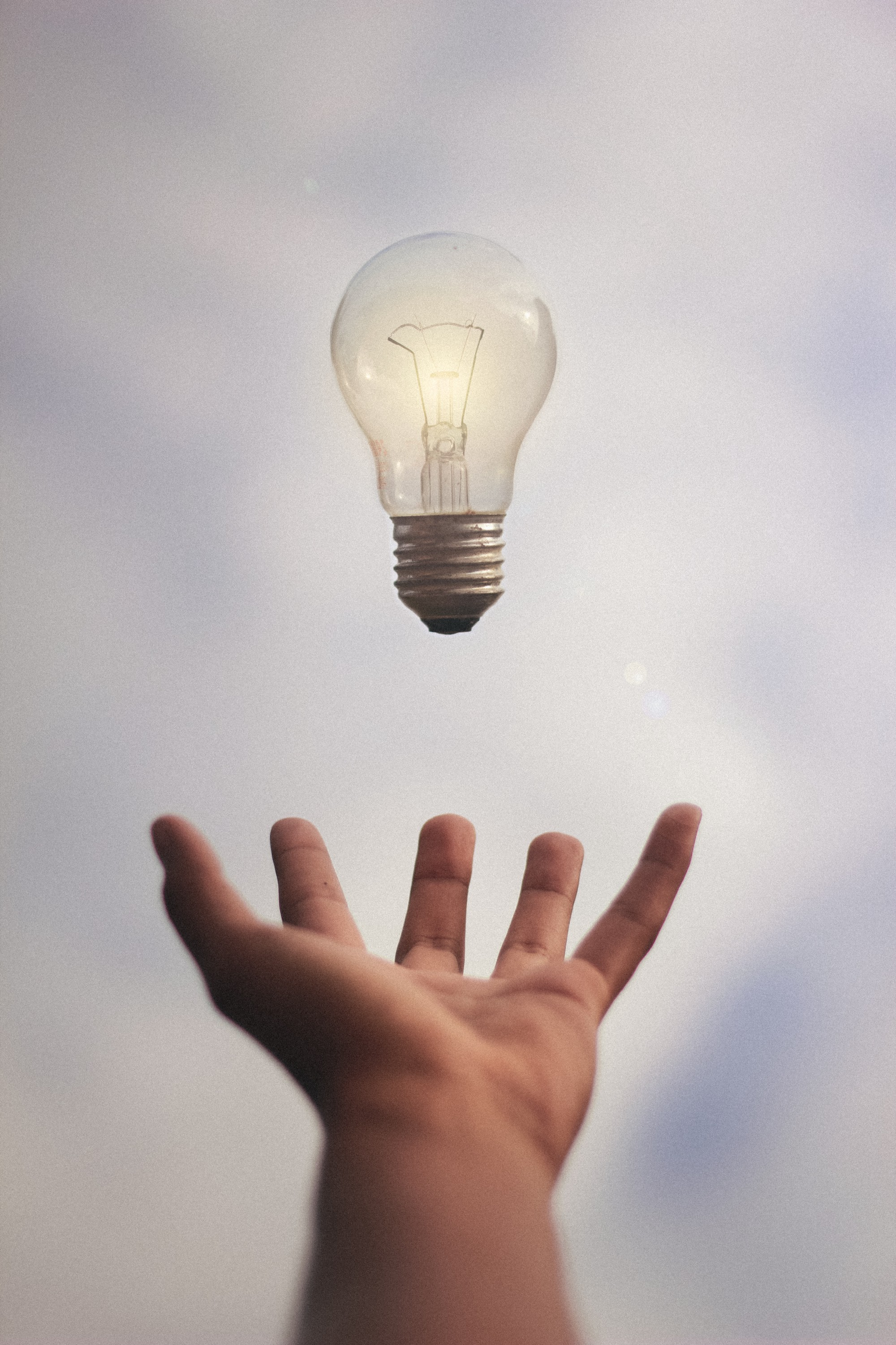 Lightbulb turned on and floating from two hands into the sky. Love and Relationship Life-Lessons make you feel like that.