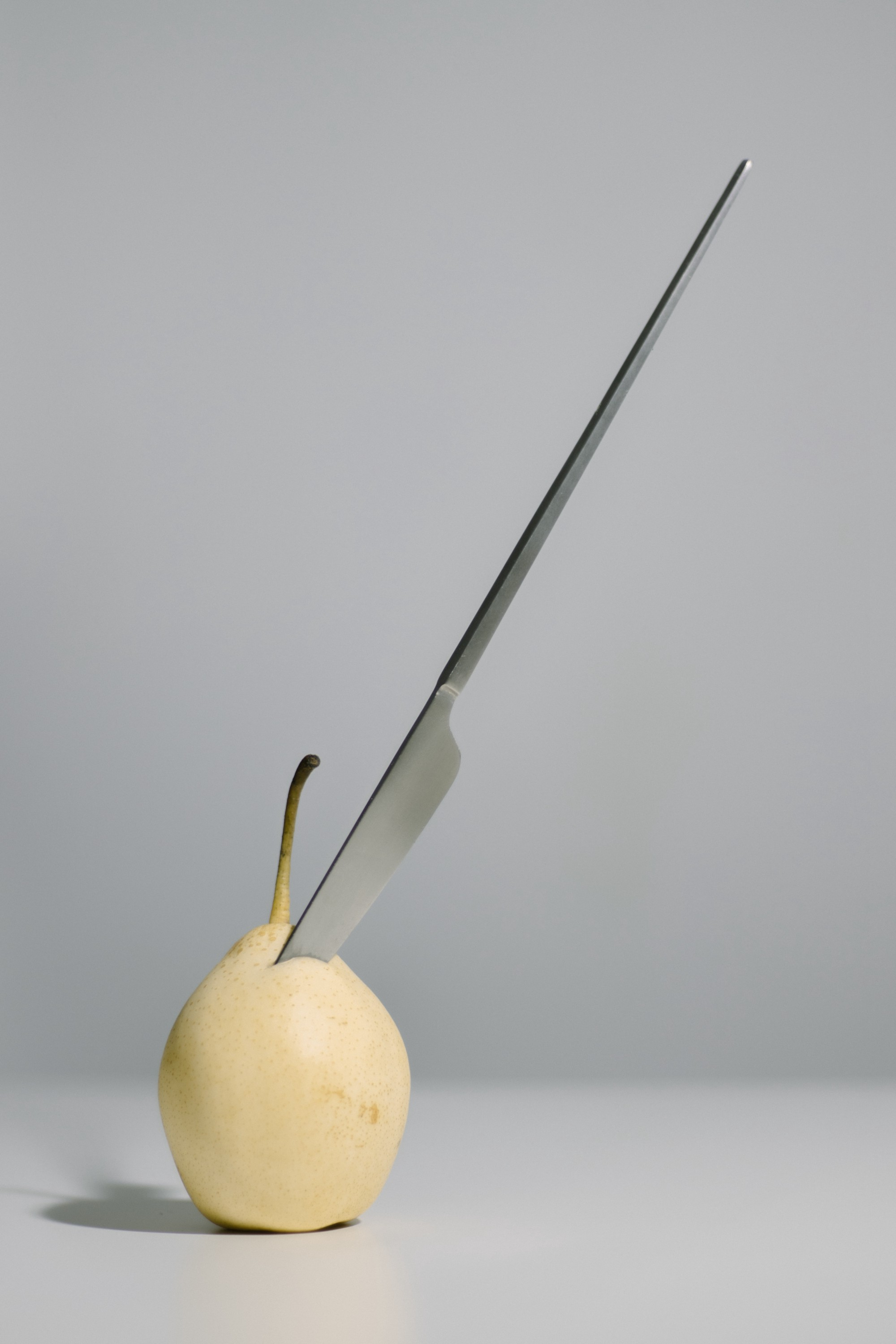 Food Research is Flawed: What's New? pic of pear with long piercing knife