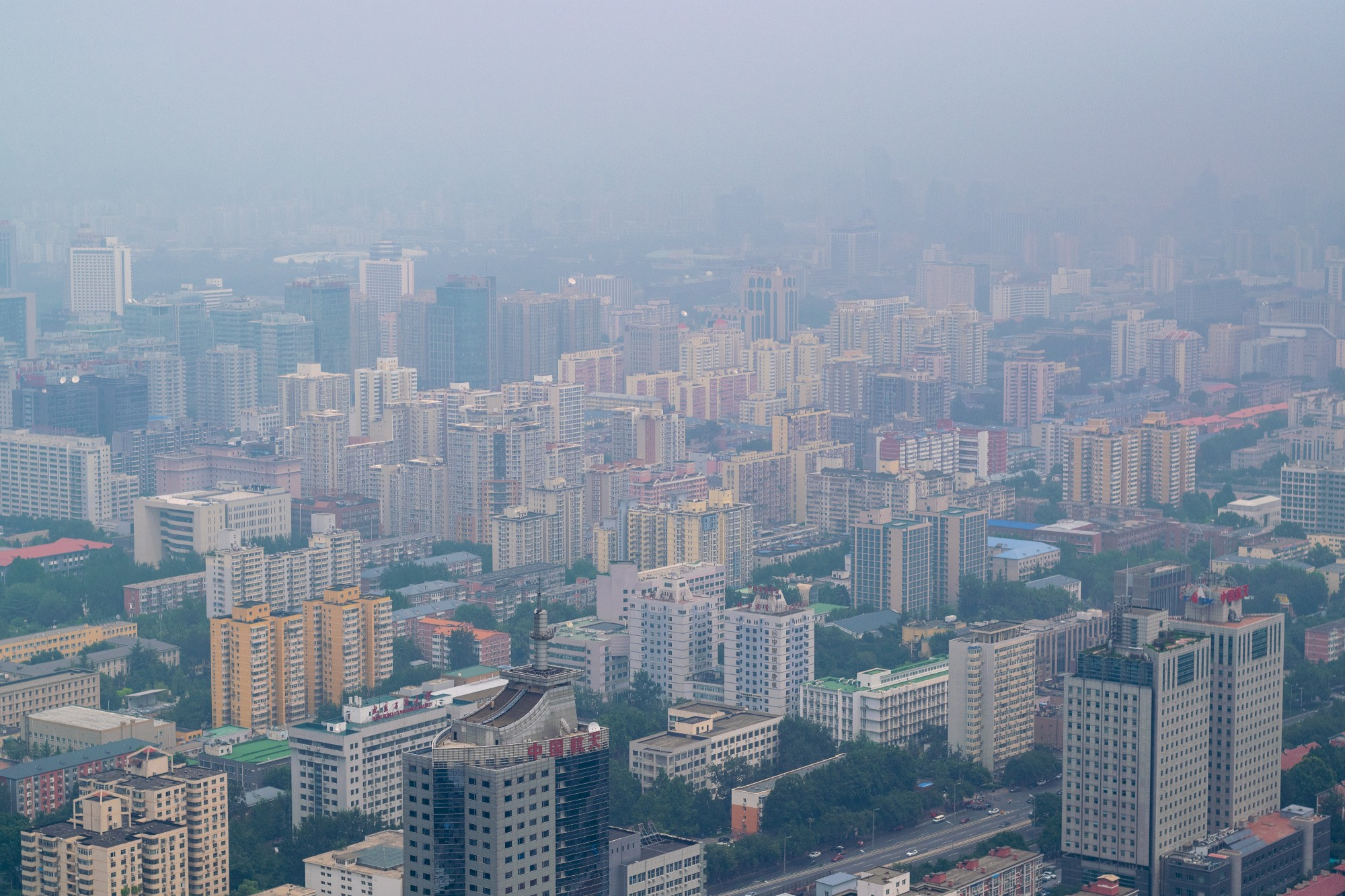 A drone view of developed city with air pollution