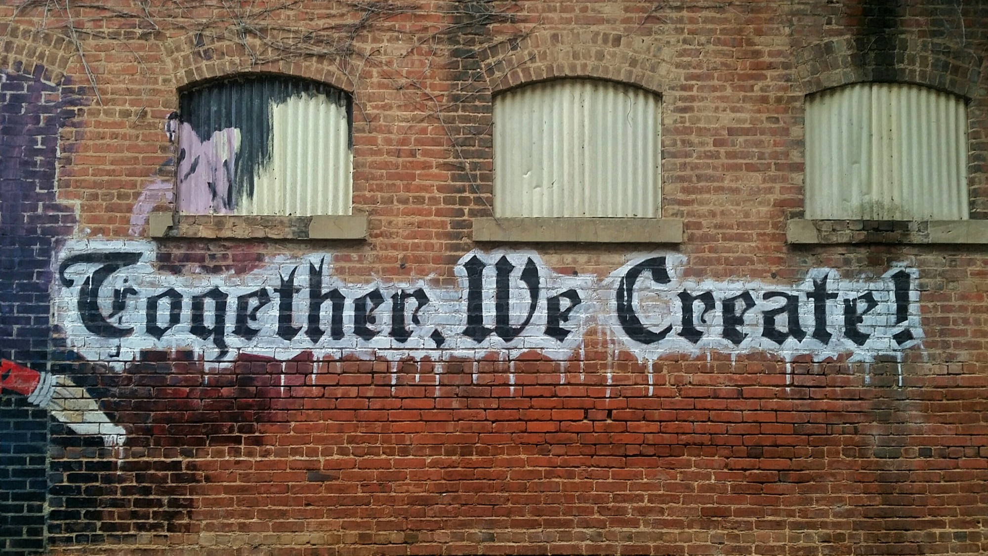 a wall with written together we create. how to find ideas for your next story