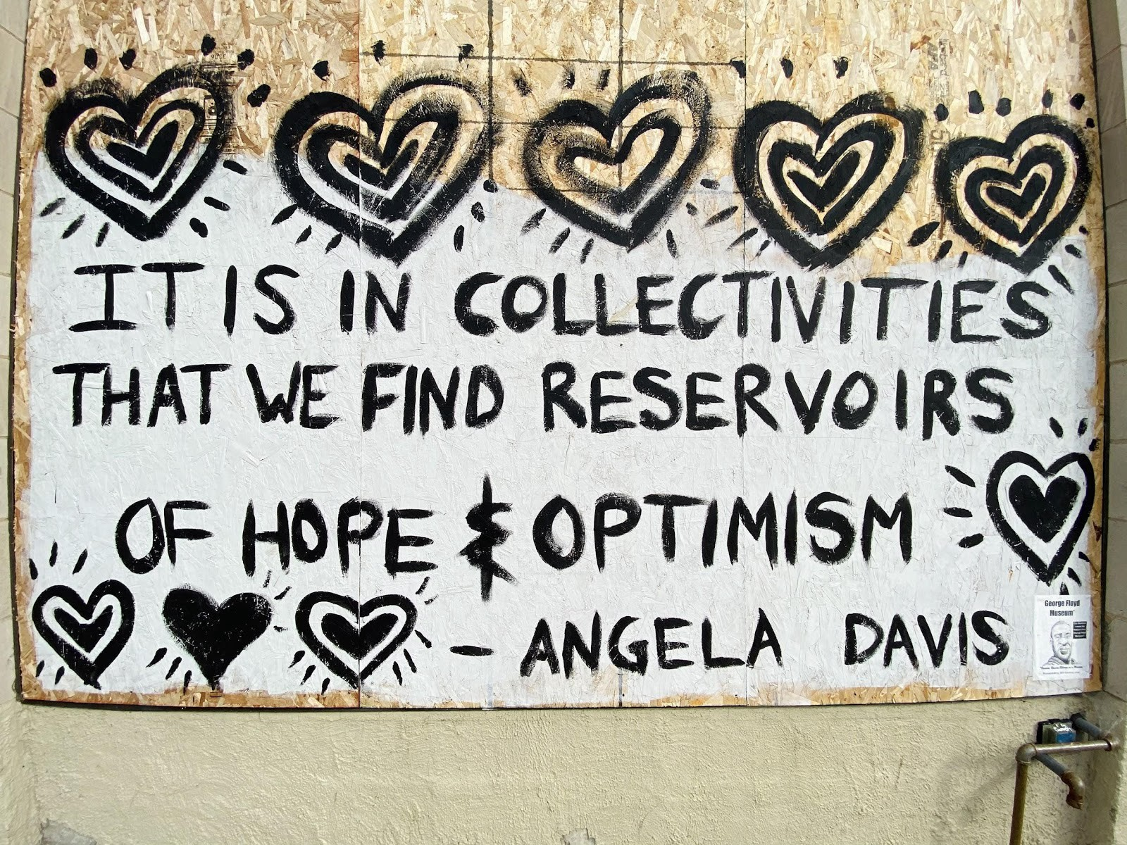 "Mural of Angela Davis quote, ""It is in collectivities that we find reservoirs of hope and optimism."""
