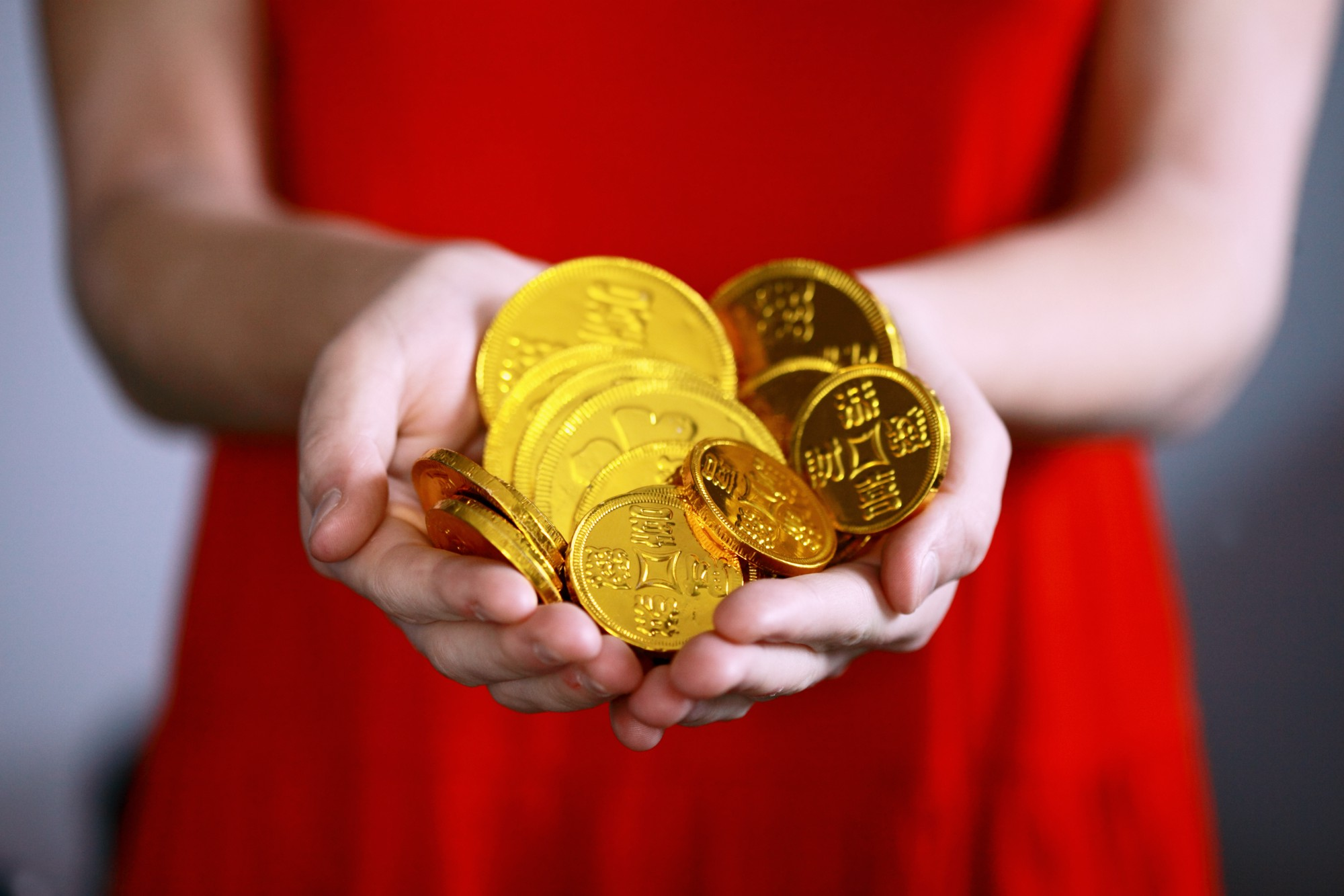 gold coins, investing in gold, gold, girl holding gold coins