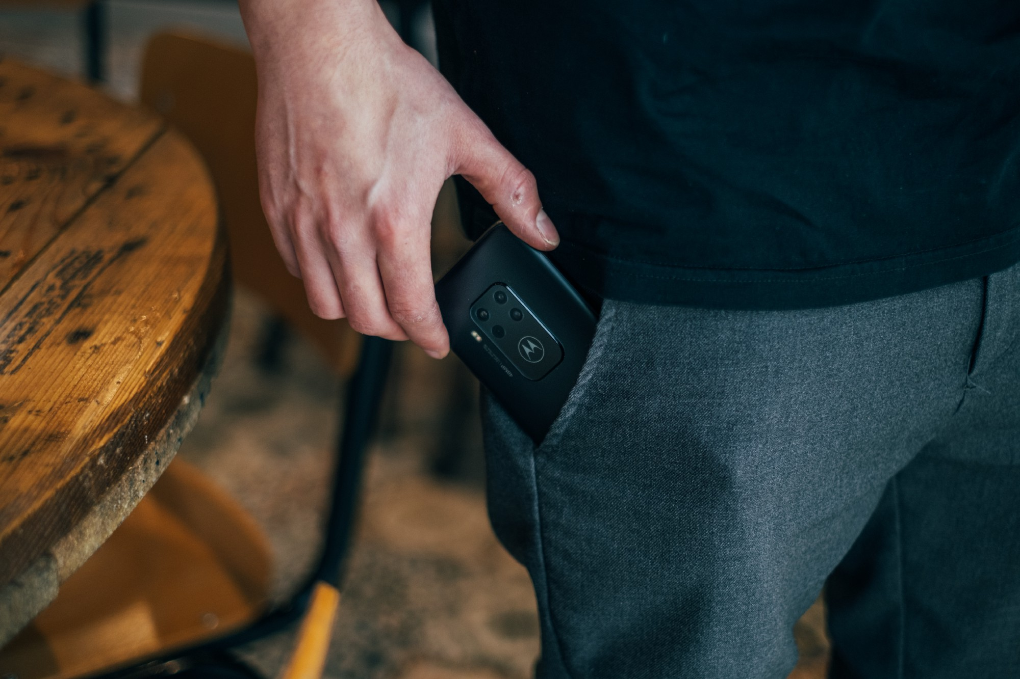 A person pulling out a phone from their pocket