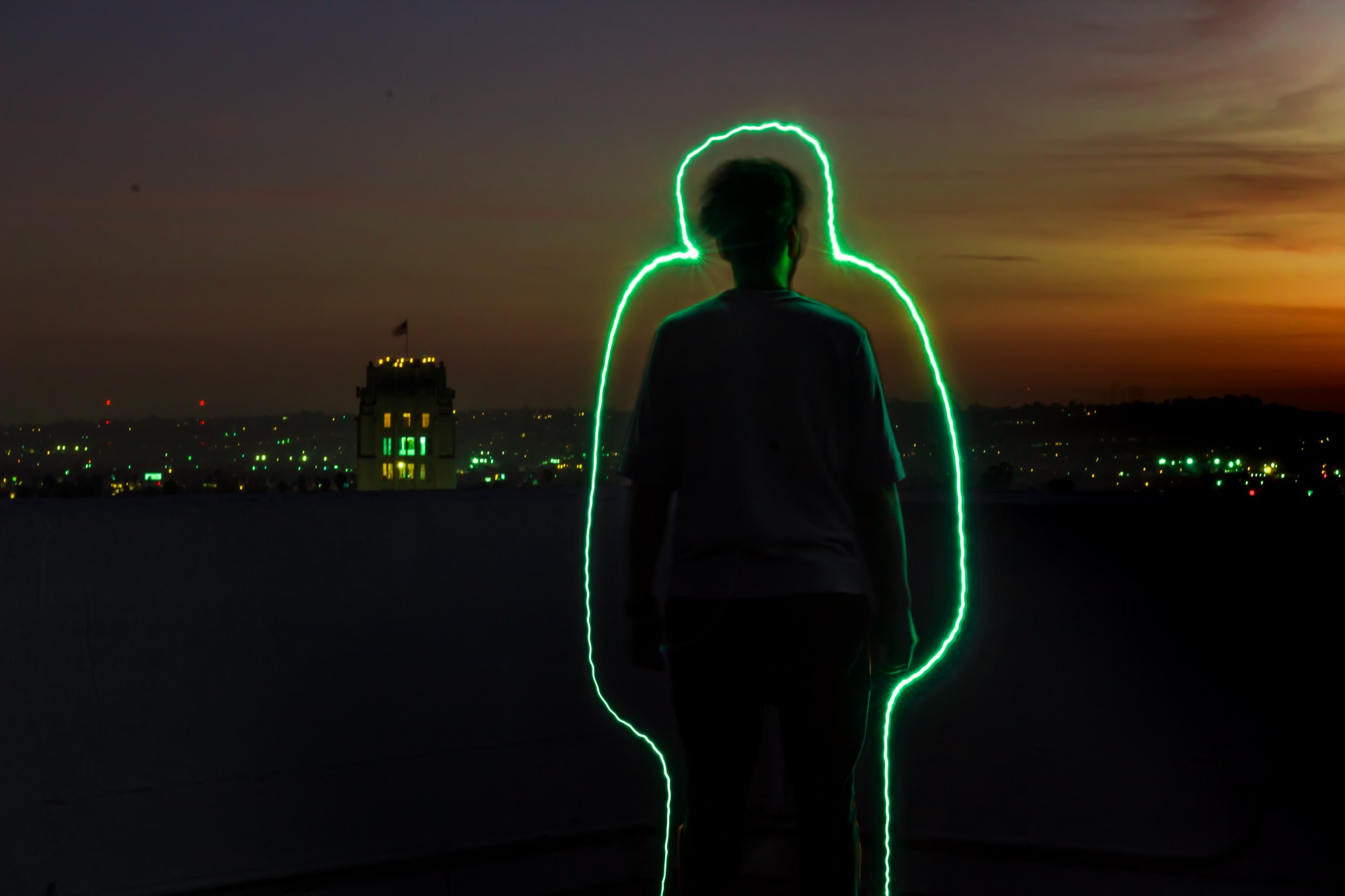 Photo of a person with a green glow outline.