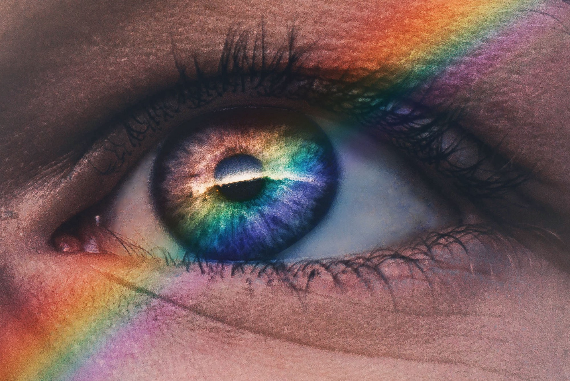 close up of eye and rainbow