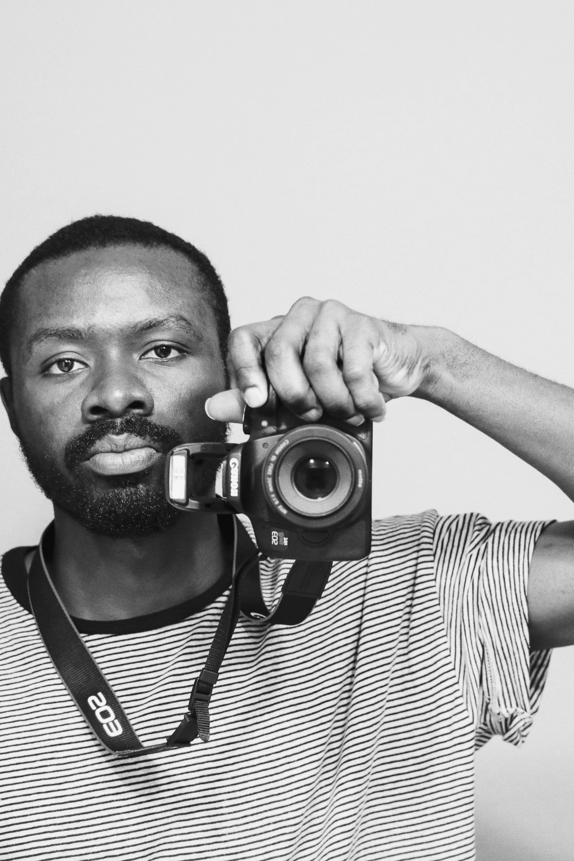 7 strategies to live a more authentic self—black and white still photo of man with camera