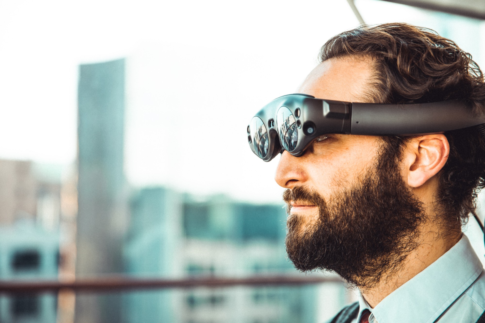 A man wearing augmented reality glasses