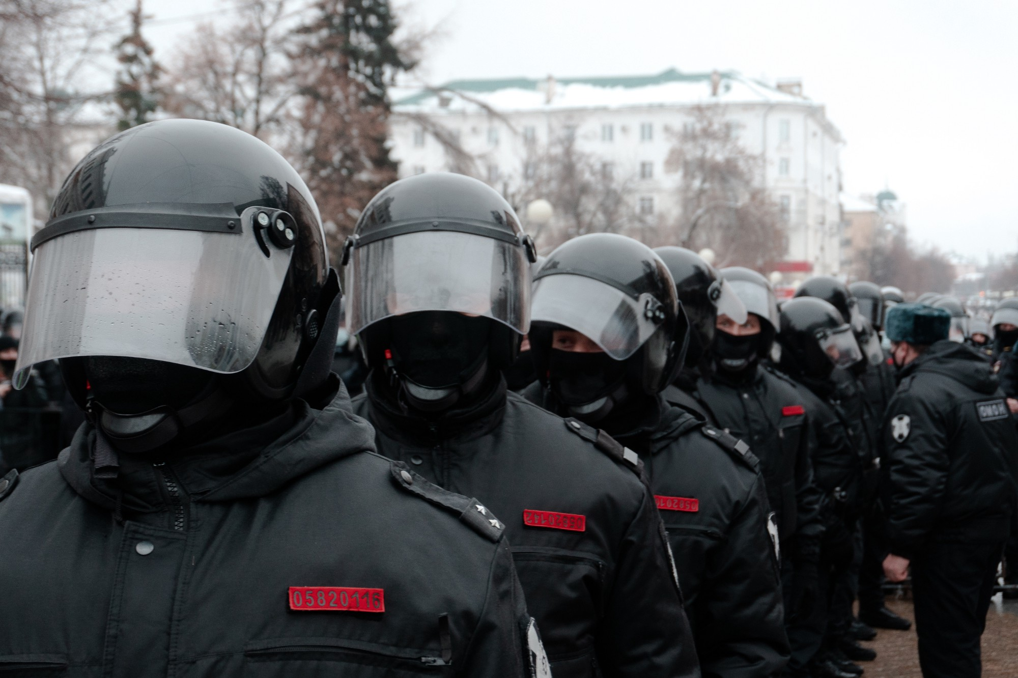 Police forces dressed in black with helmets.