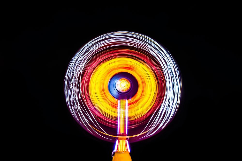 Illuminated carnival ride with speed effects