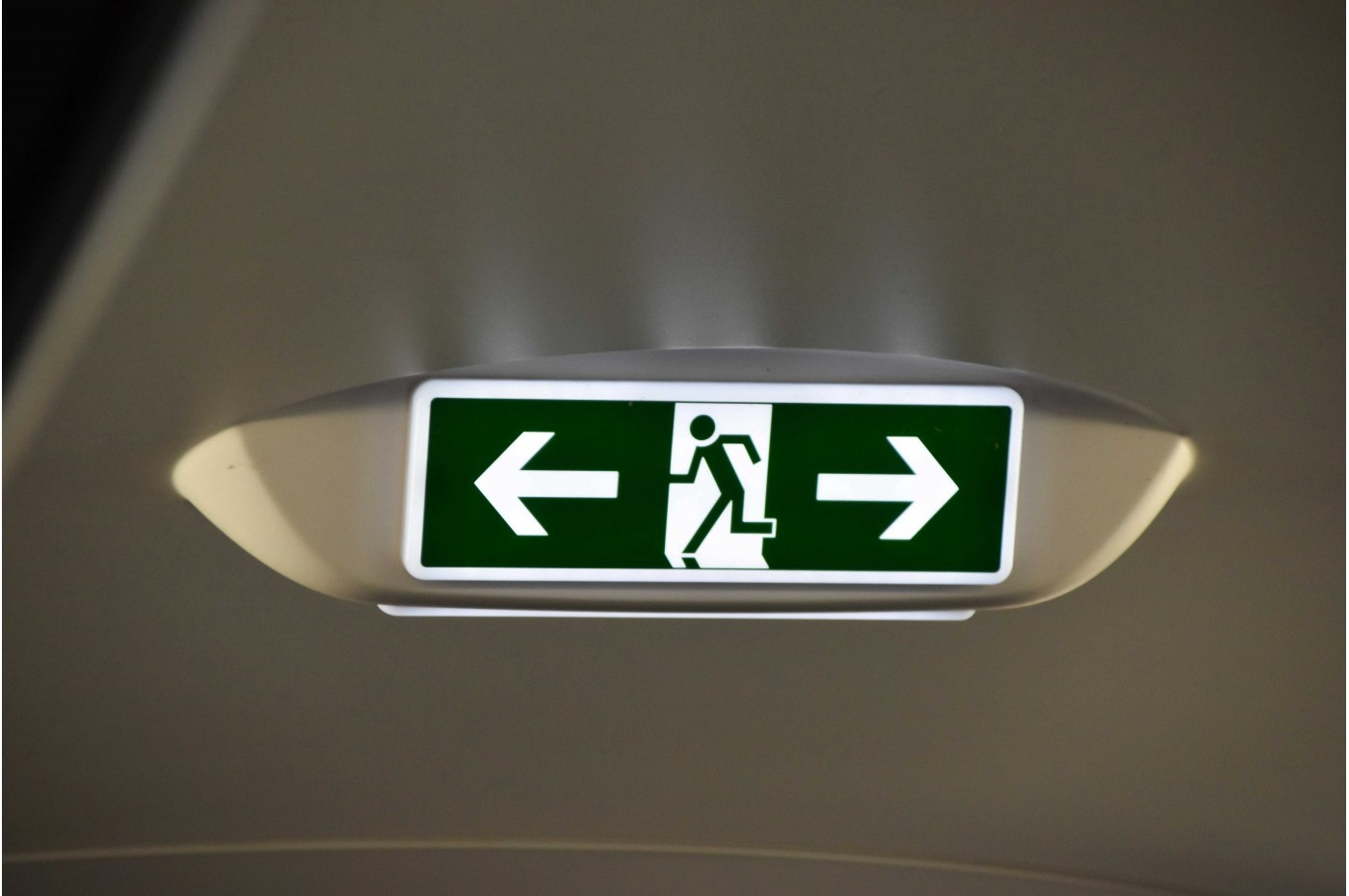 Sign pointing to emergency exits