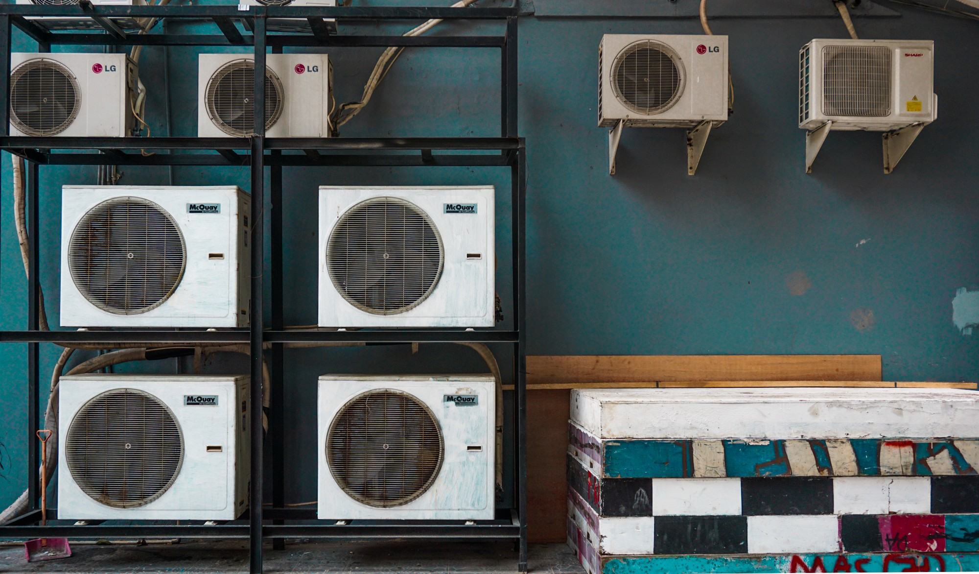 Air conditioners placed on a blue wall