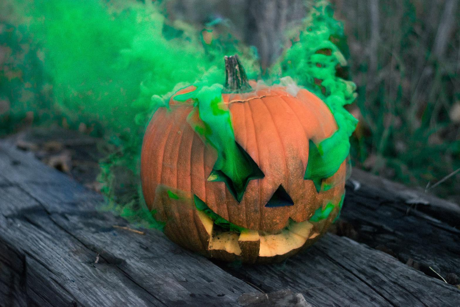 jack-o'-lantern with green smoke coming out of the eyes