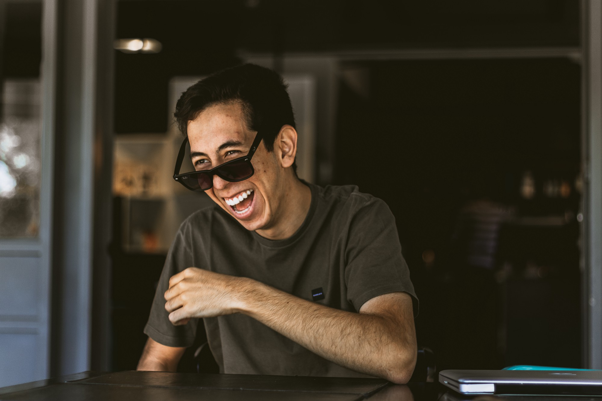 man in sunglasses, laughing