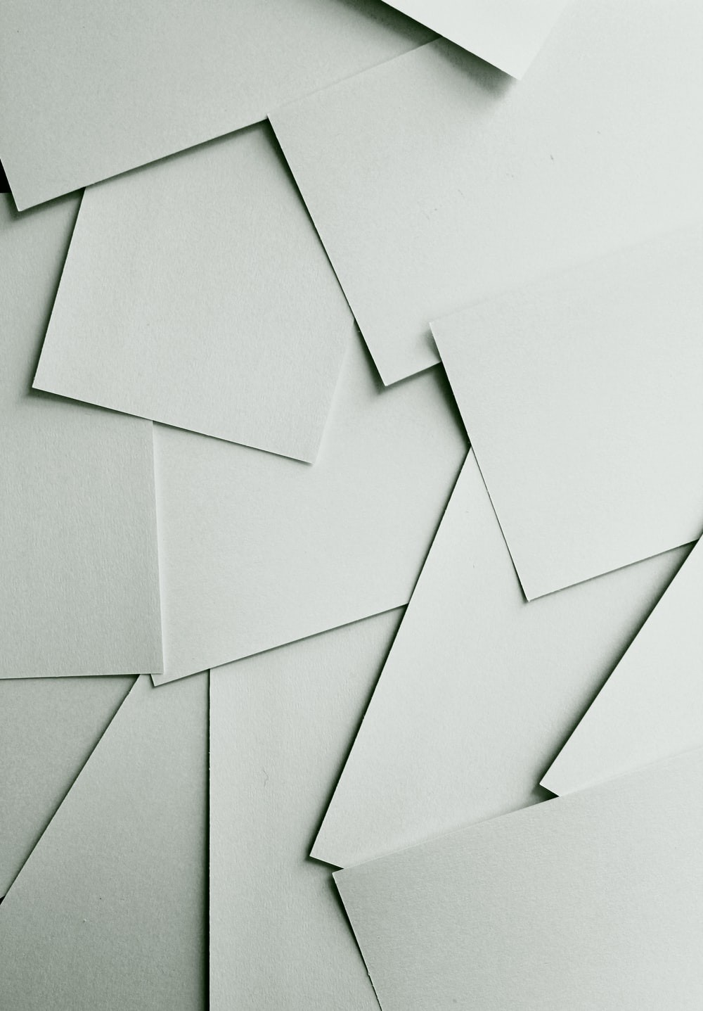 Scattered sheets of white paper