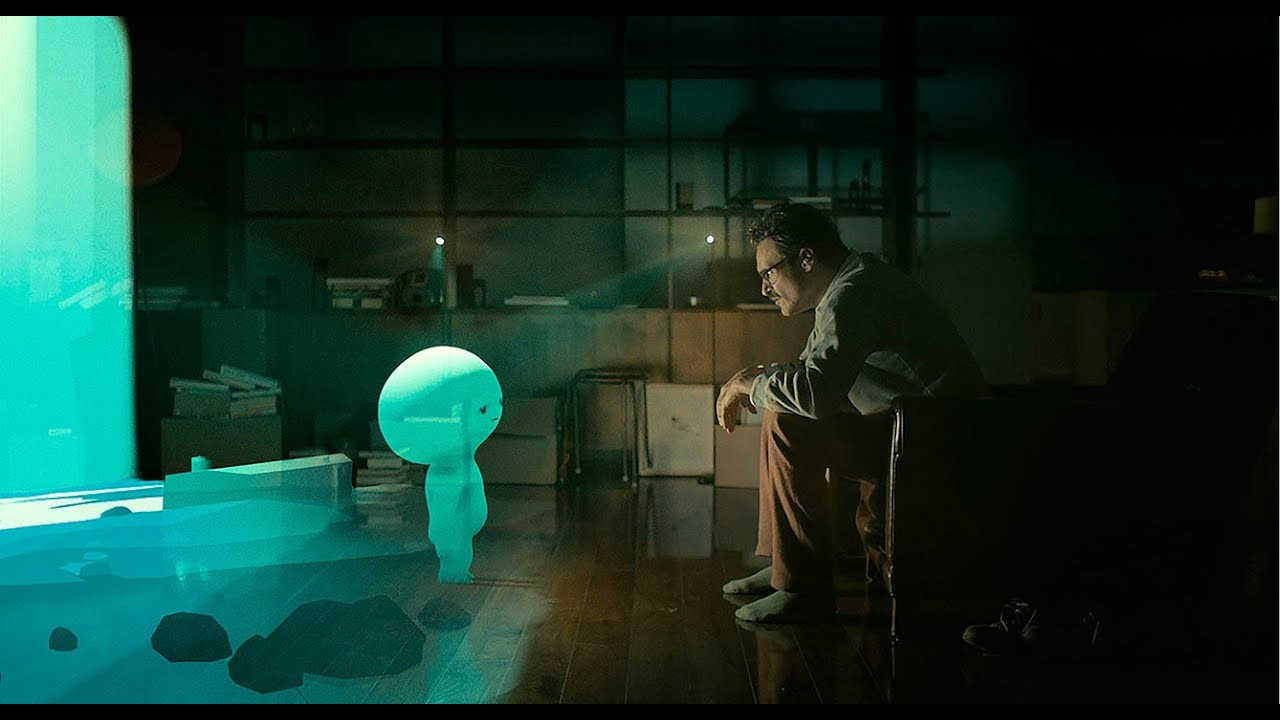 Image of man looking at hologram from the movie Her released in 2013