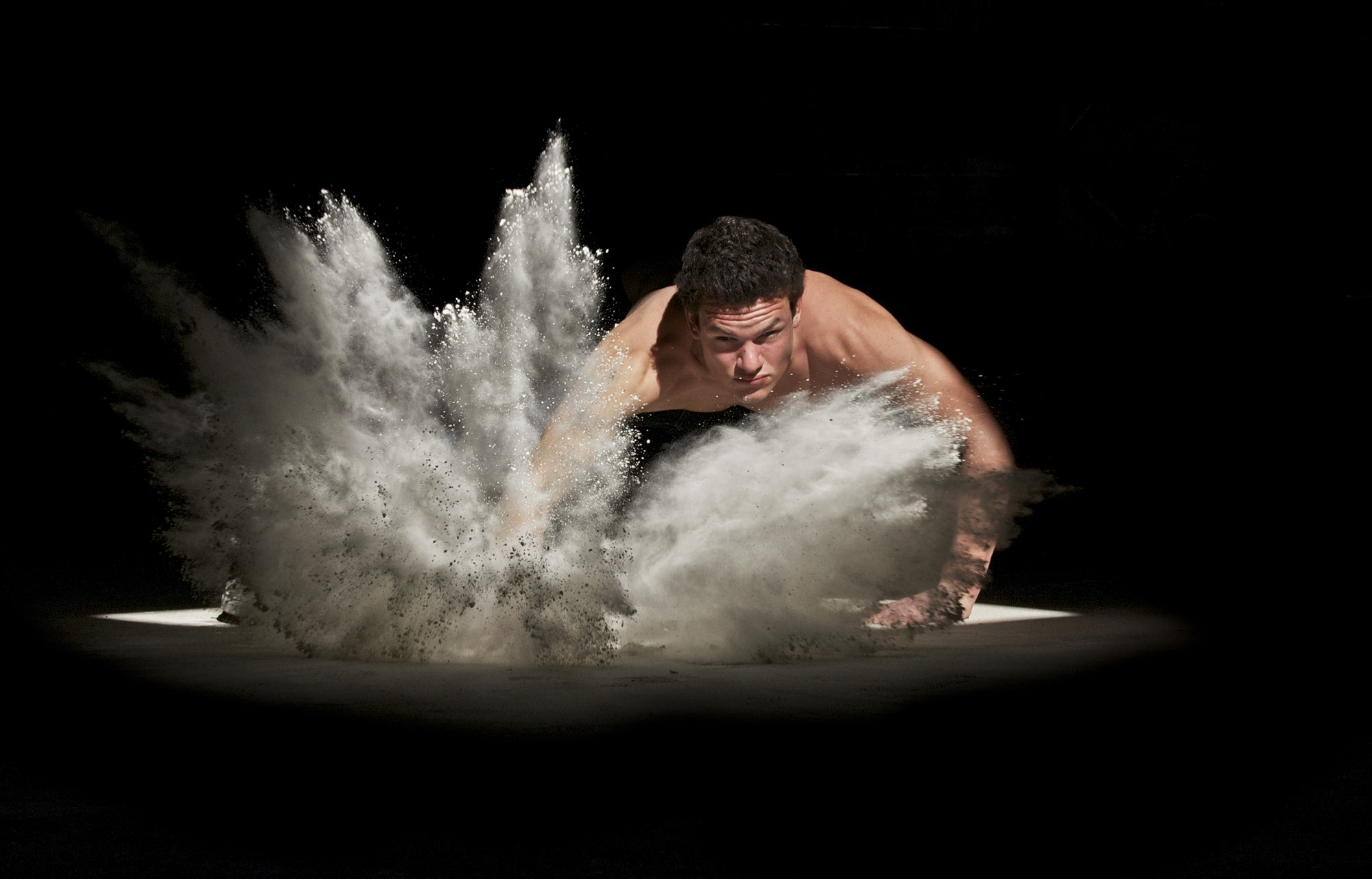 A martial arts fighter stomping the powder on the ground